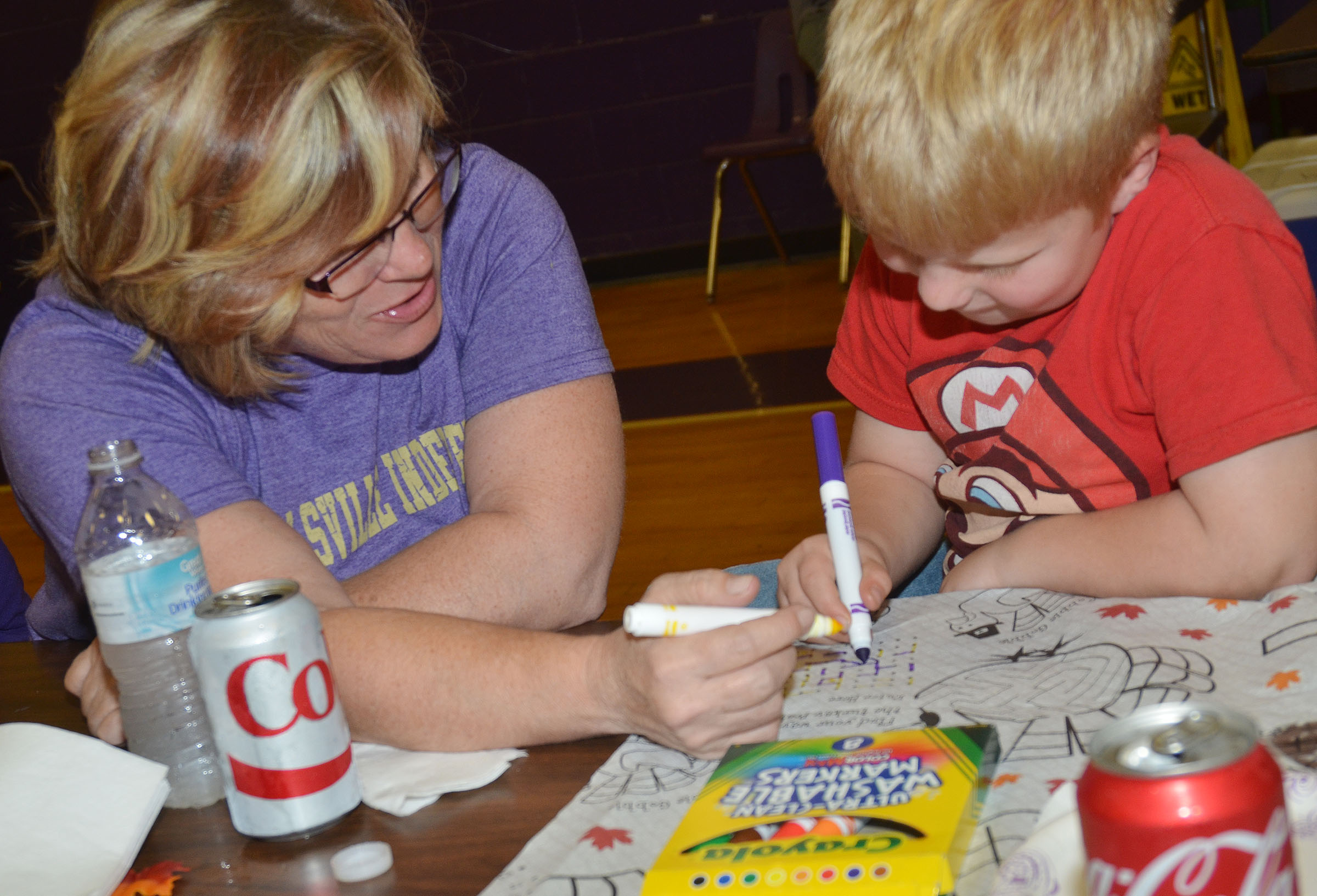 Melinda Parrott colors with her son, Ben, a first-grader.