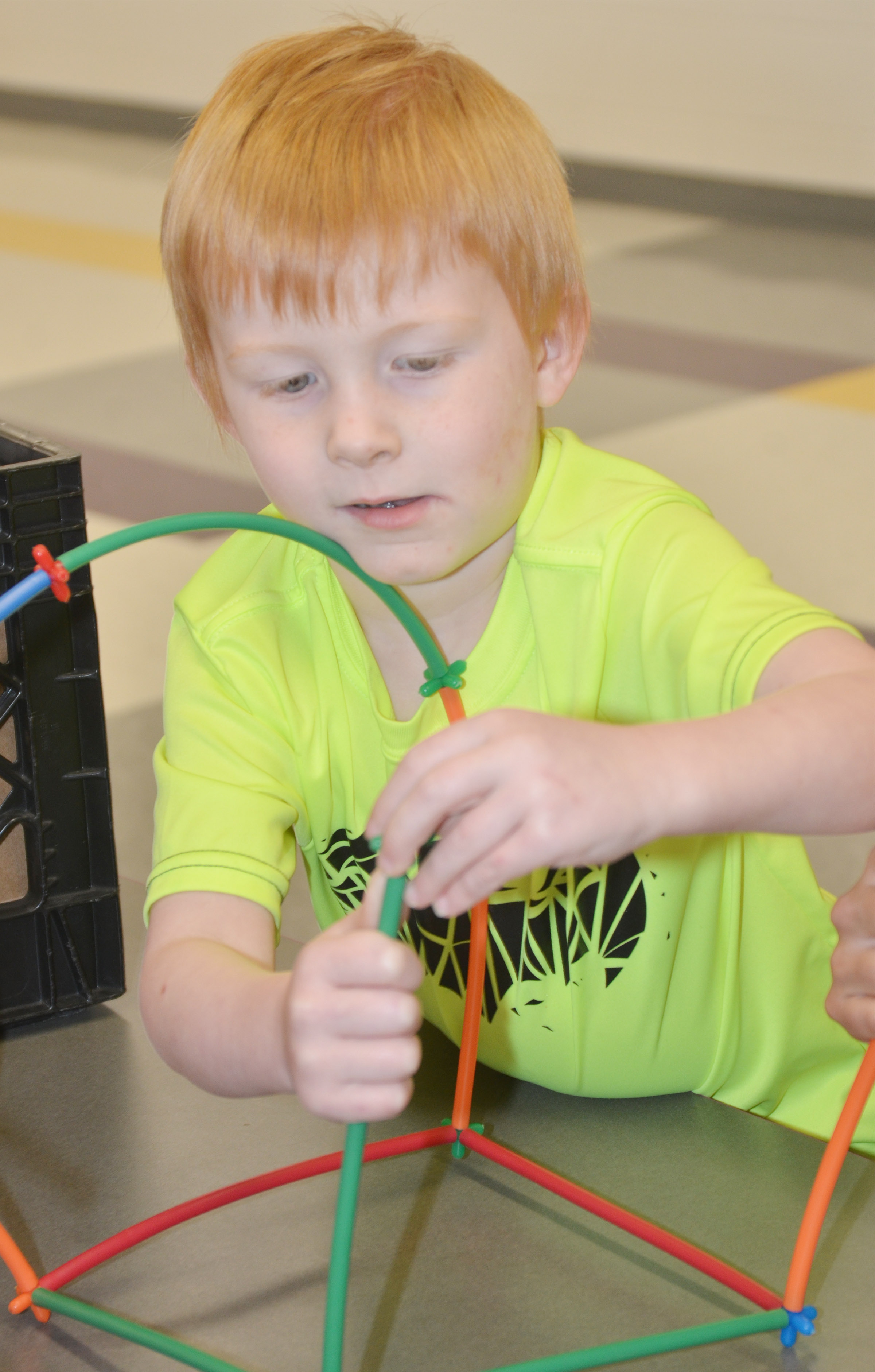 CES kindergartener Jayden Maupin builds with connectors.