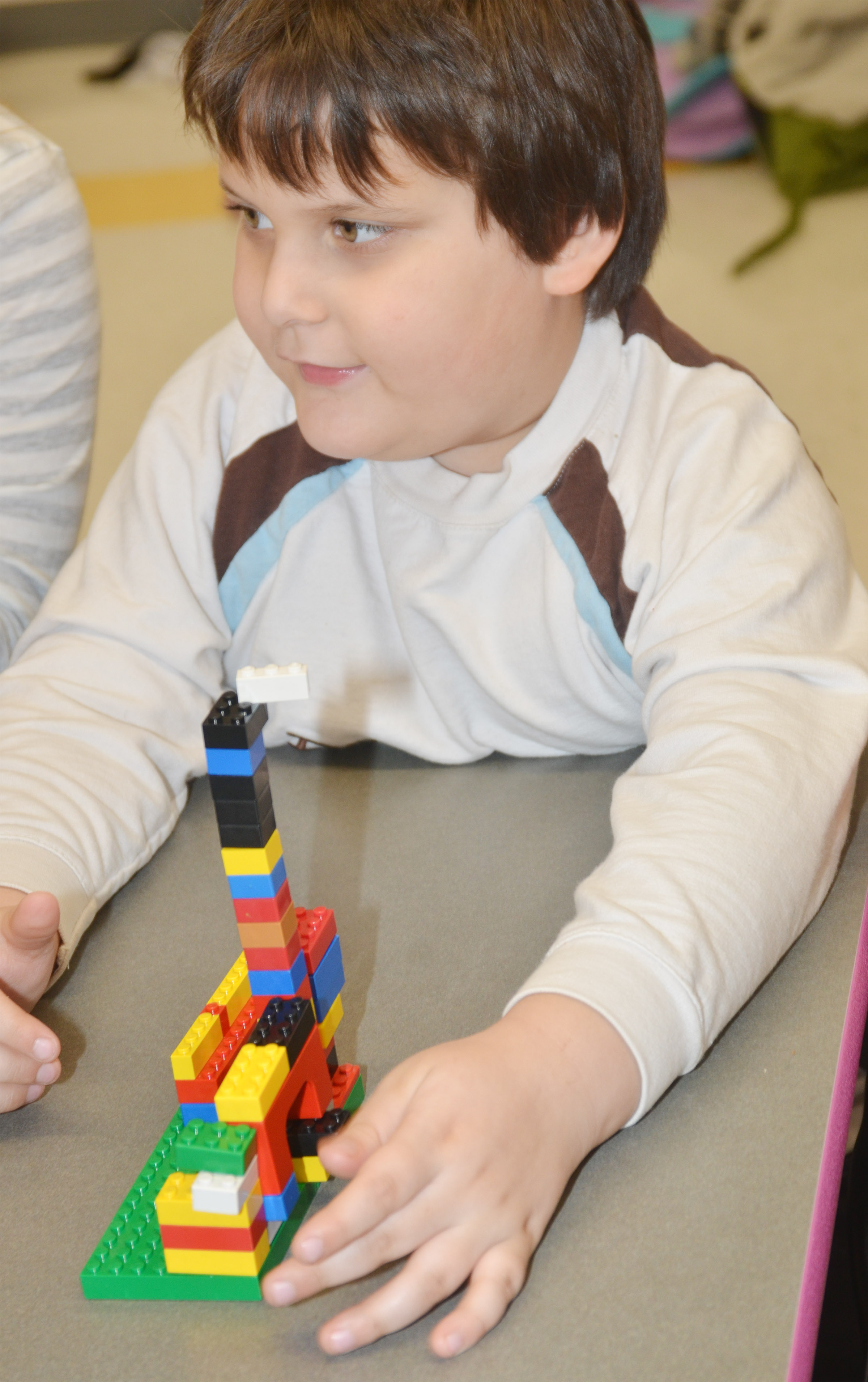 CES kindergartener Cloud Malone builds with Legos.