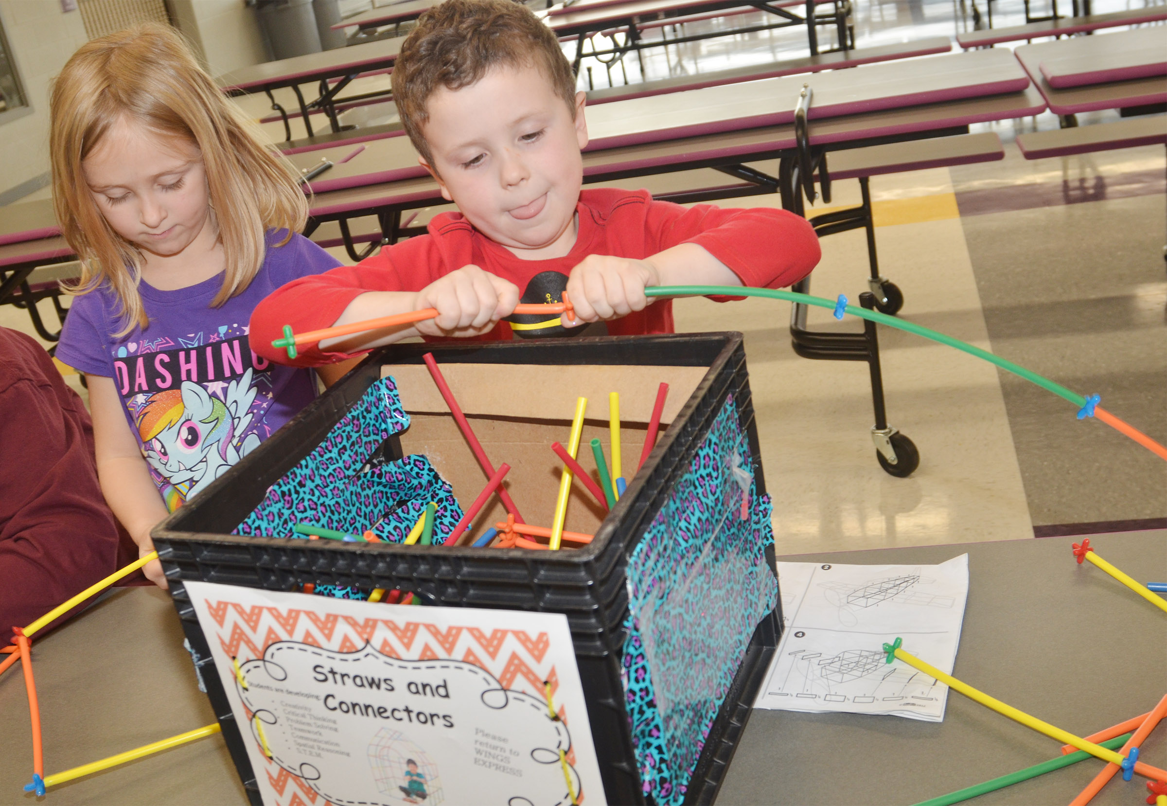 CES kindergarteners LeeAnna Garvin, at left, and Brayden Perkins build with connectors.