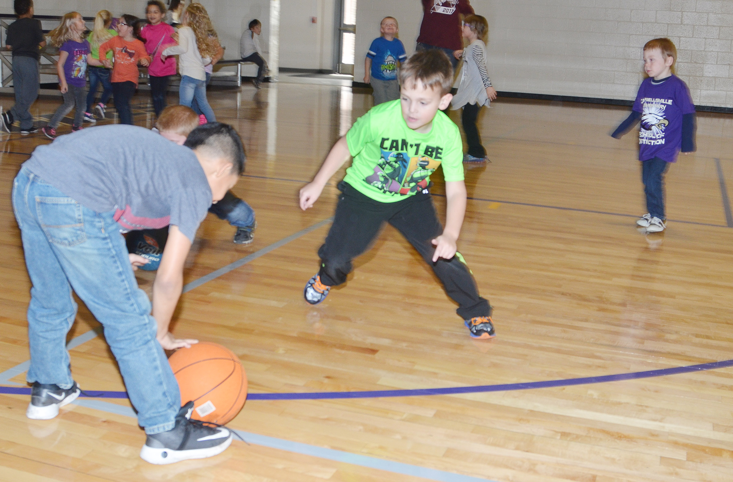CES first-grader Brendan Martin plays basketball.