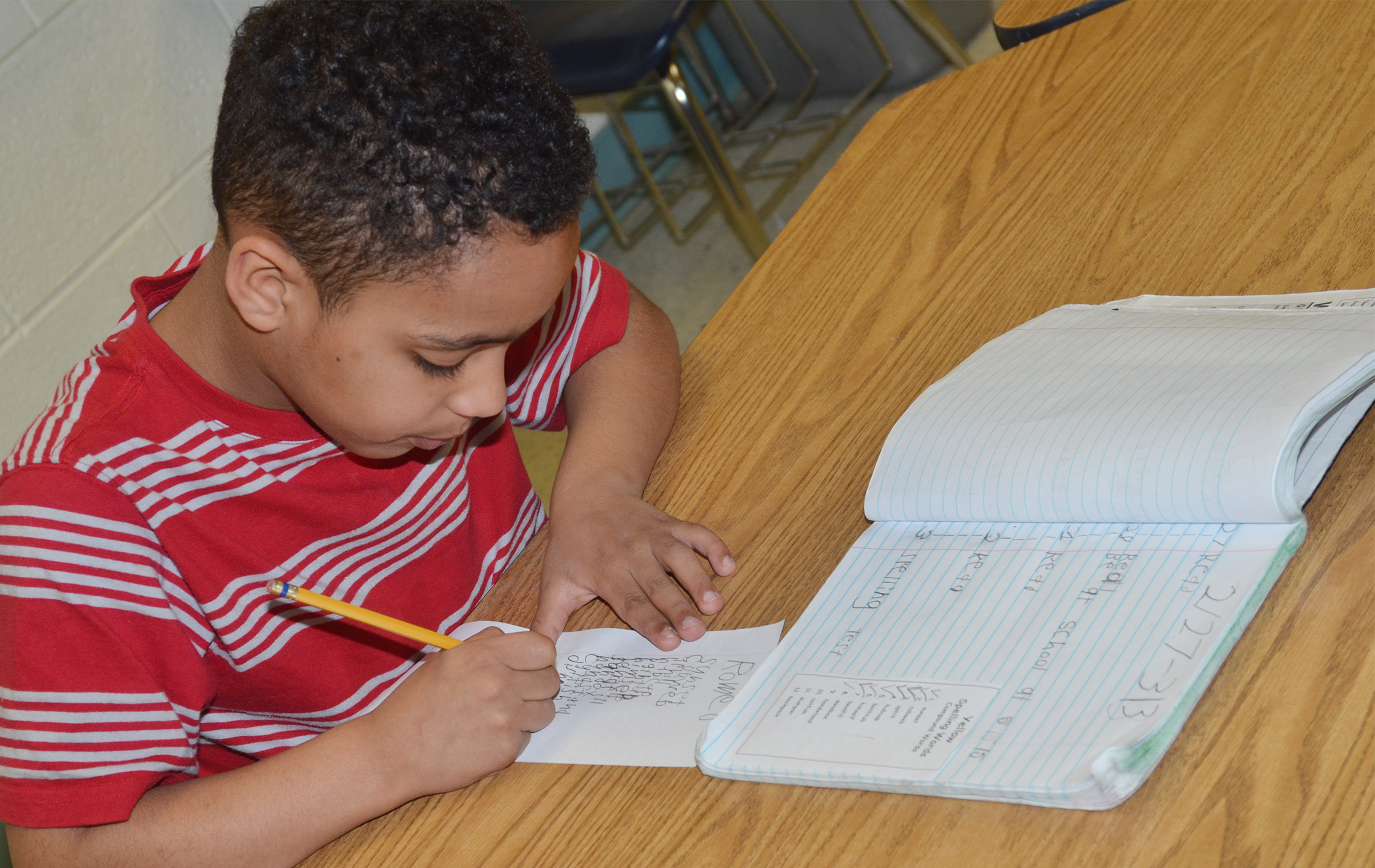 CES first-grader Jo'van Goins writes his sight words.