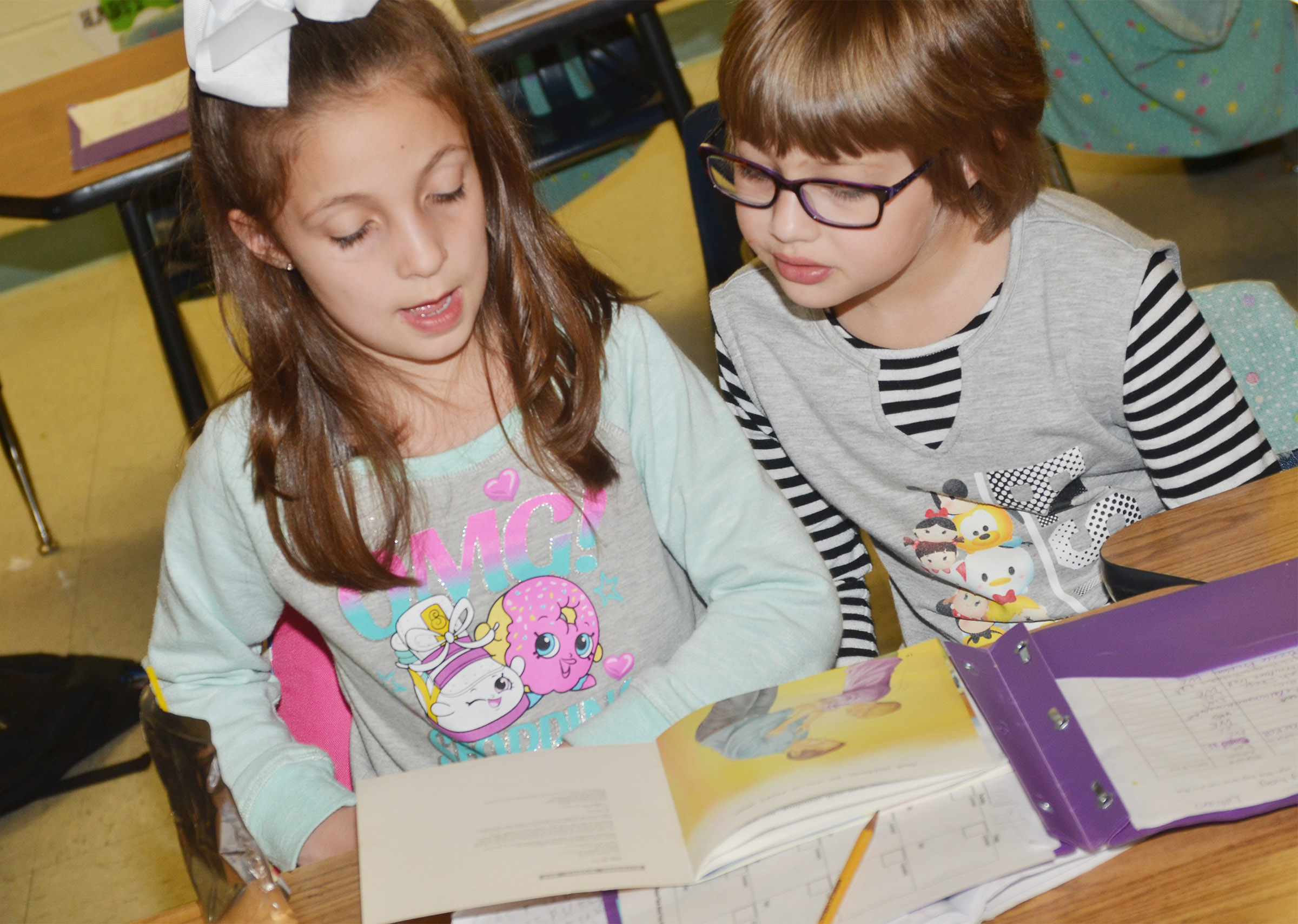 CES first-graders Lillian Martin, at left, and Addelyn Dooley read together.