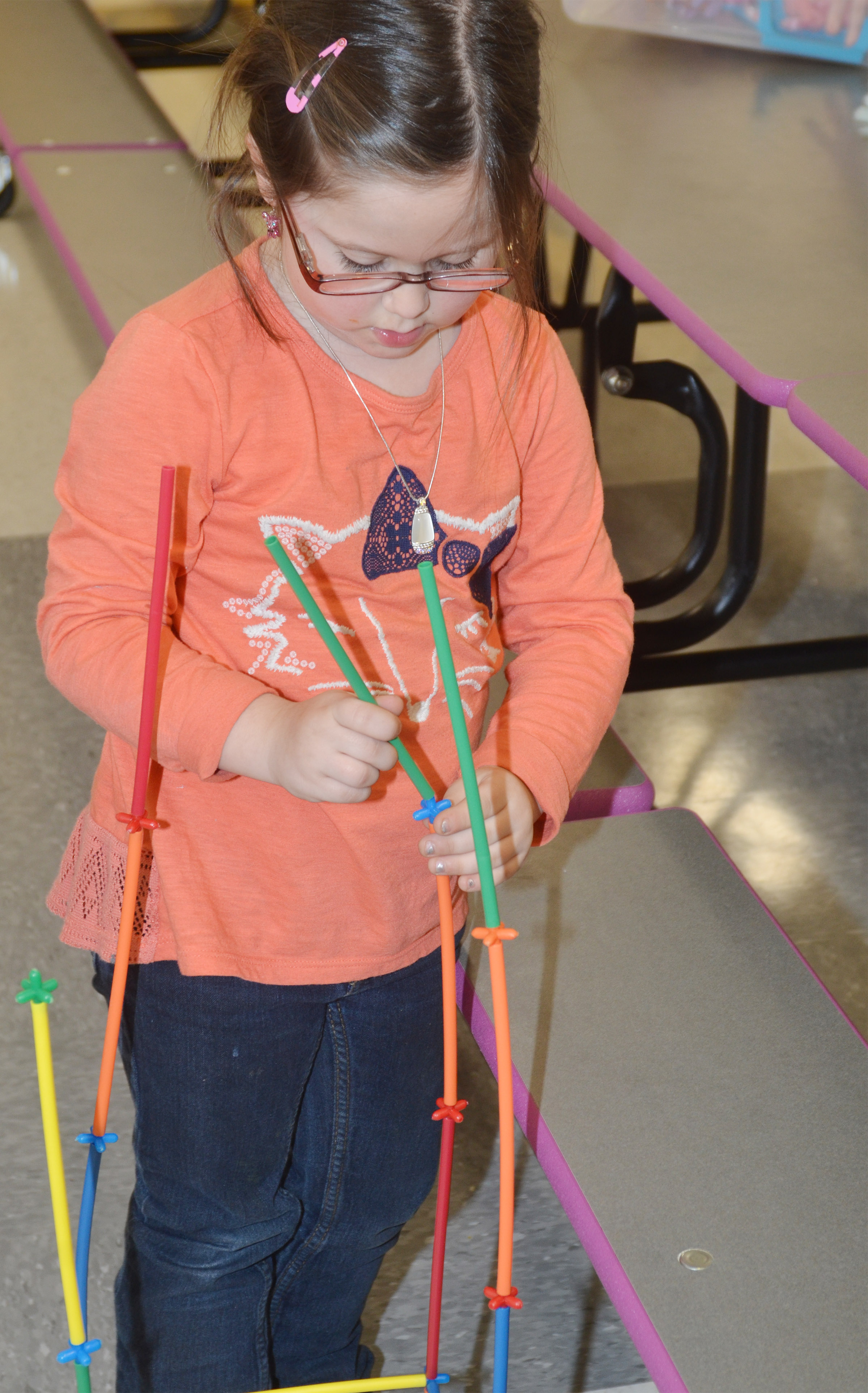 CES kindergartener Trinity Clark builds with connectors.