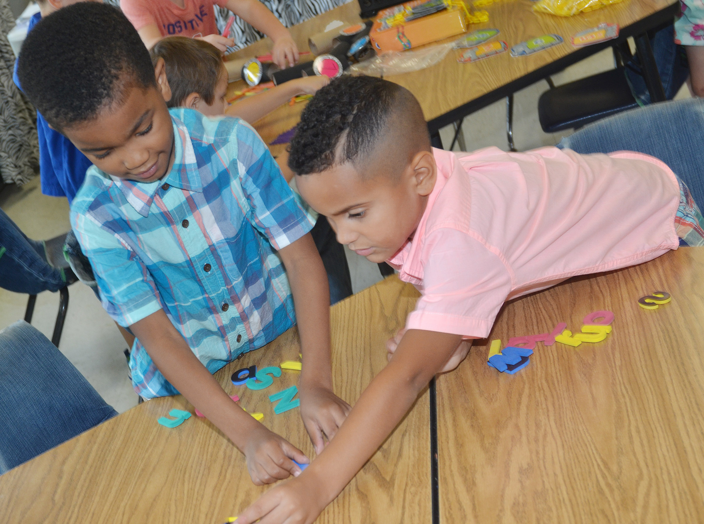 CES kindergarteners Donavon Bell, at left, and Kingston Cowherd pair uppercase letters with their lowercase partners.