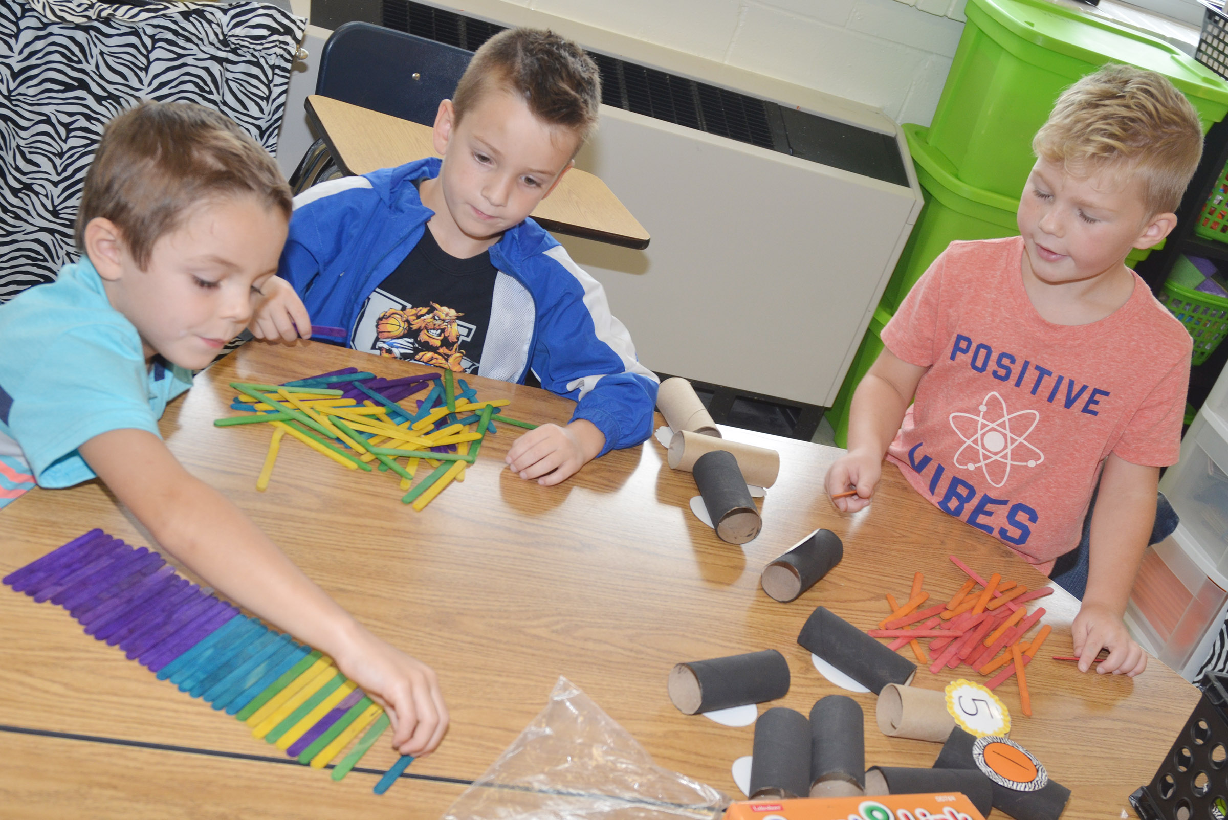 From left, CES kindergarteners Hayden Goff, Cash Davis and Landry Brown count by using sticks and cardboard tubes.