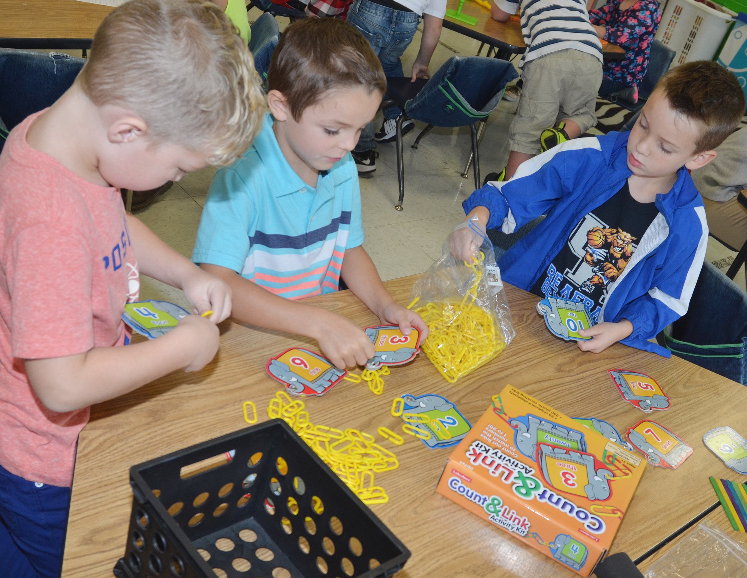 From left, CES kindergarteners Landry Brown, Hayden Goff and Cash Davis count by using sticks and cardboard tubes.