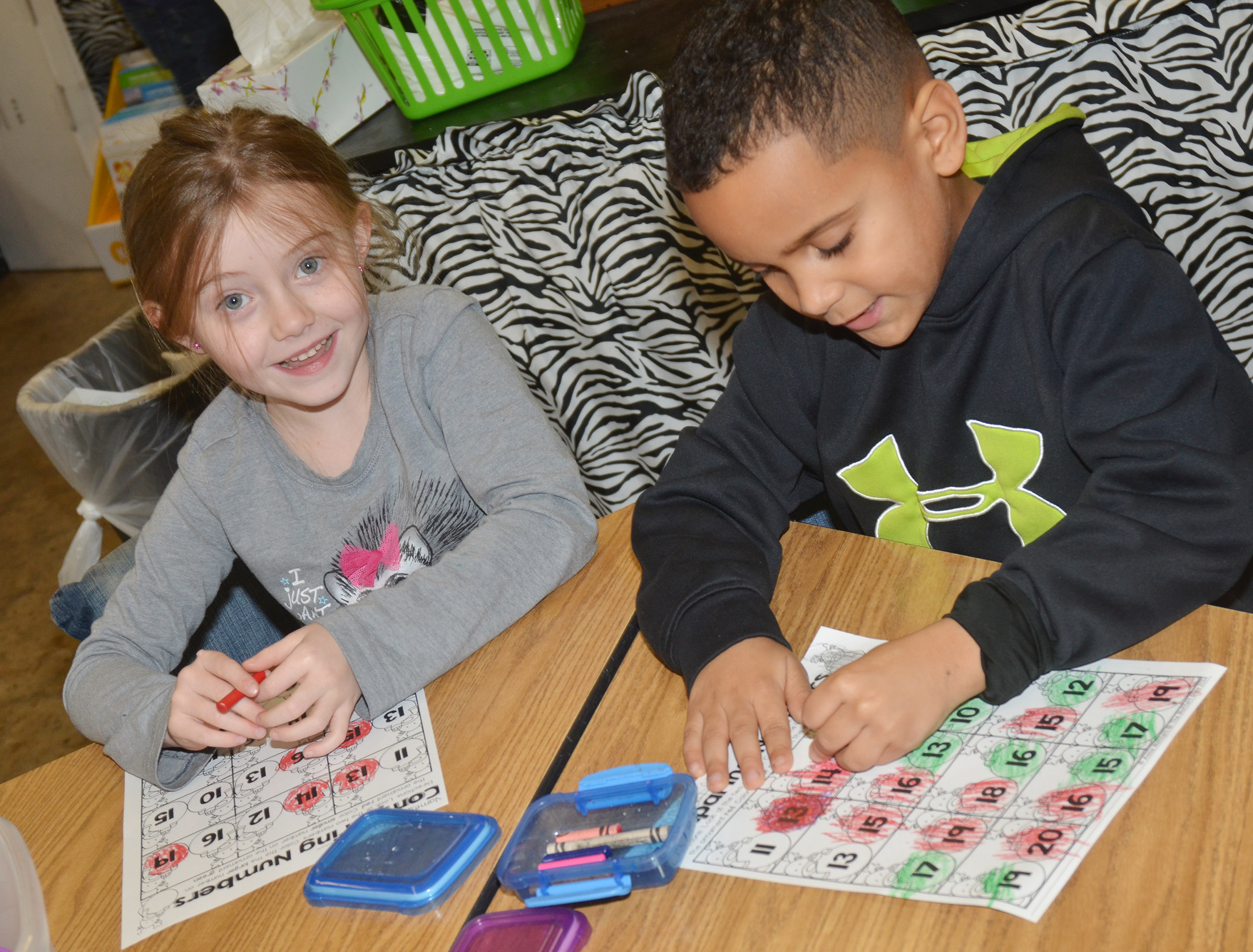 CES kindergarteners Courtney Gilbert, at left, and Kingston Cowherd practice comparing numbers to see which is the largest.
