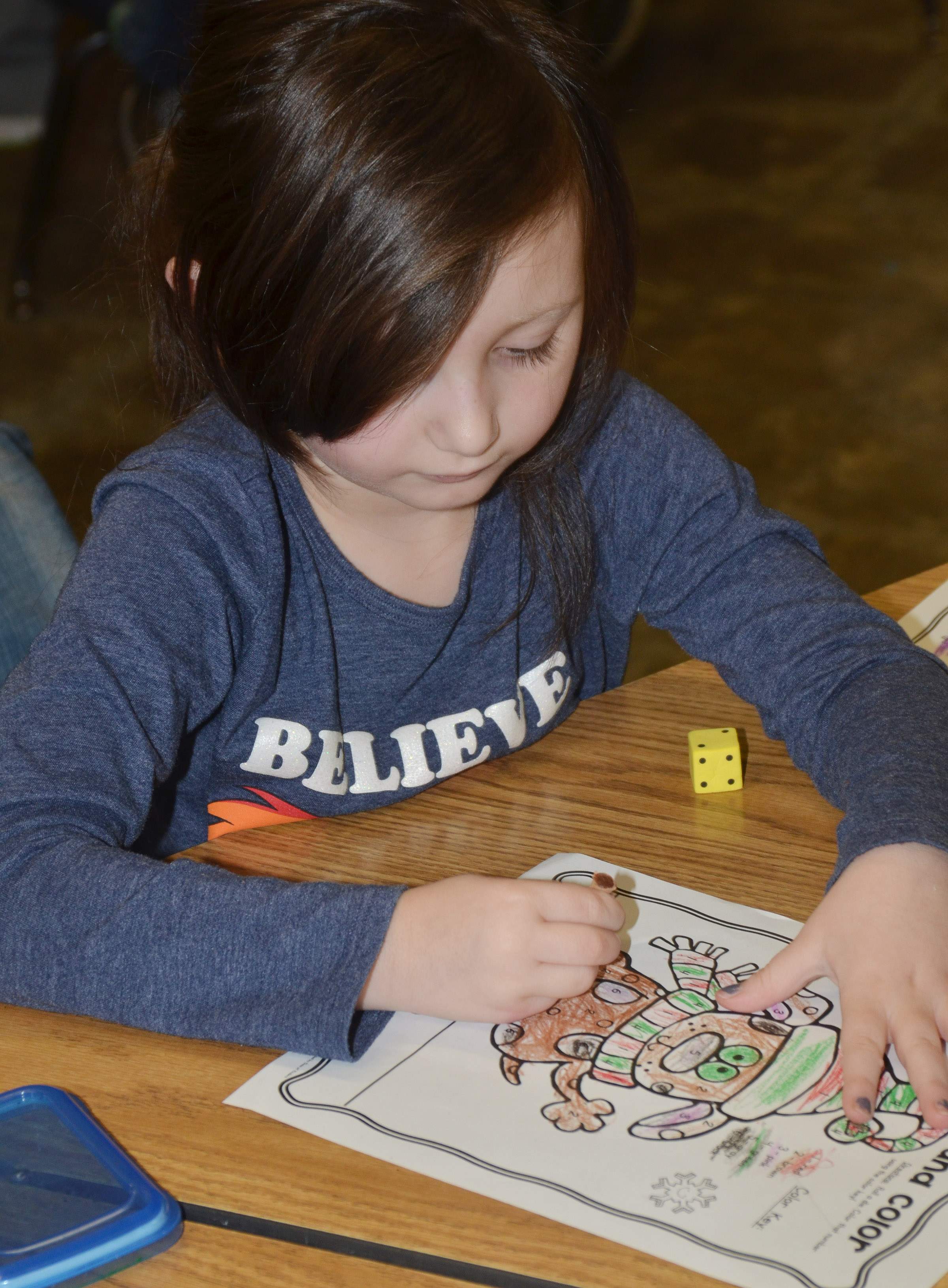 CES kindergartener Abigail Smith colors her Christmas reindeer.