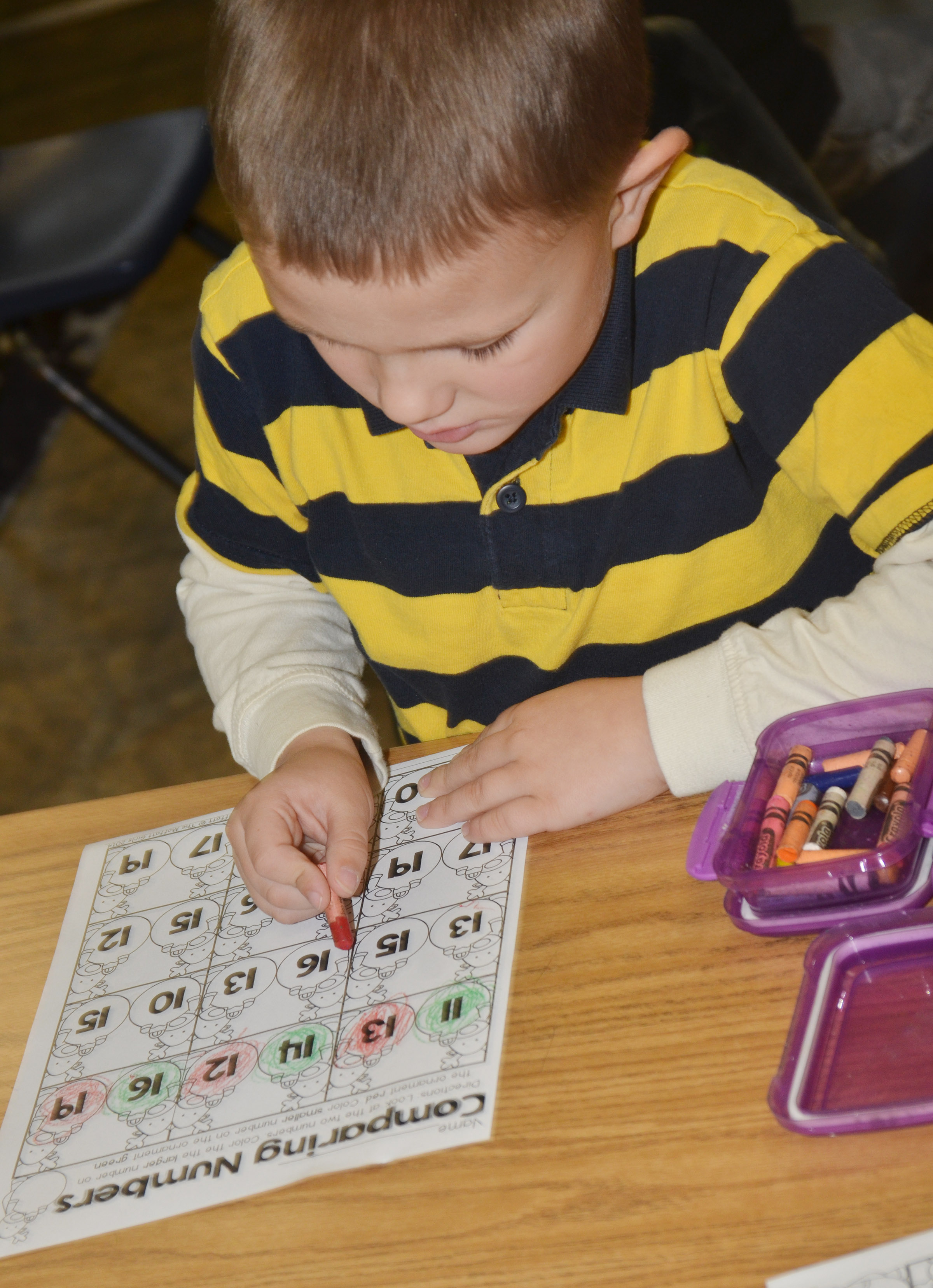 CES kindergartener Dawson Morton practices comparing numbers to see which is the largest.