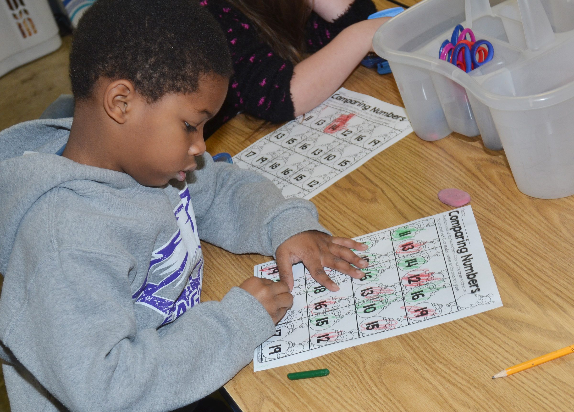 CES kindergartener Kaiyden Vancleave practices comparing numbers to see which is the largest.