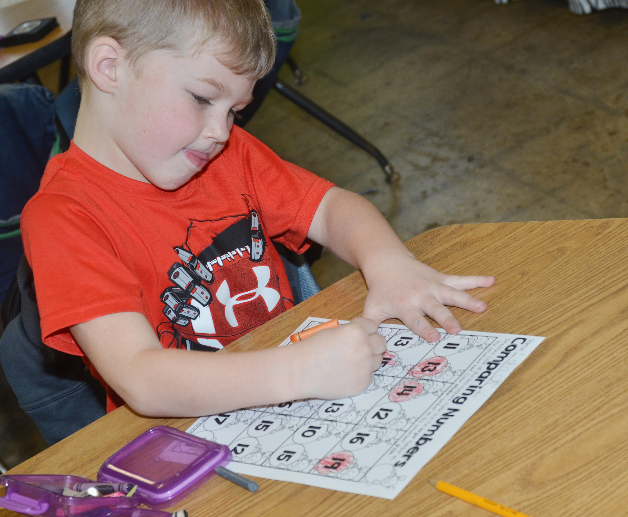 CES kindergartener Landry Brown practices comparing numbers to see which is the largest.