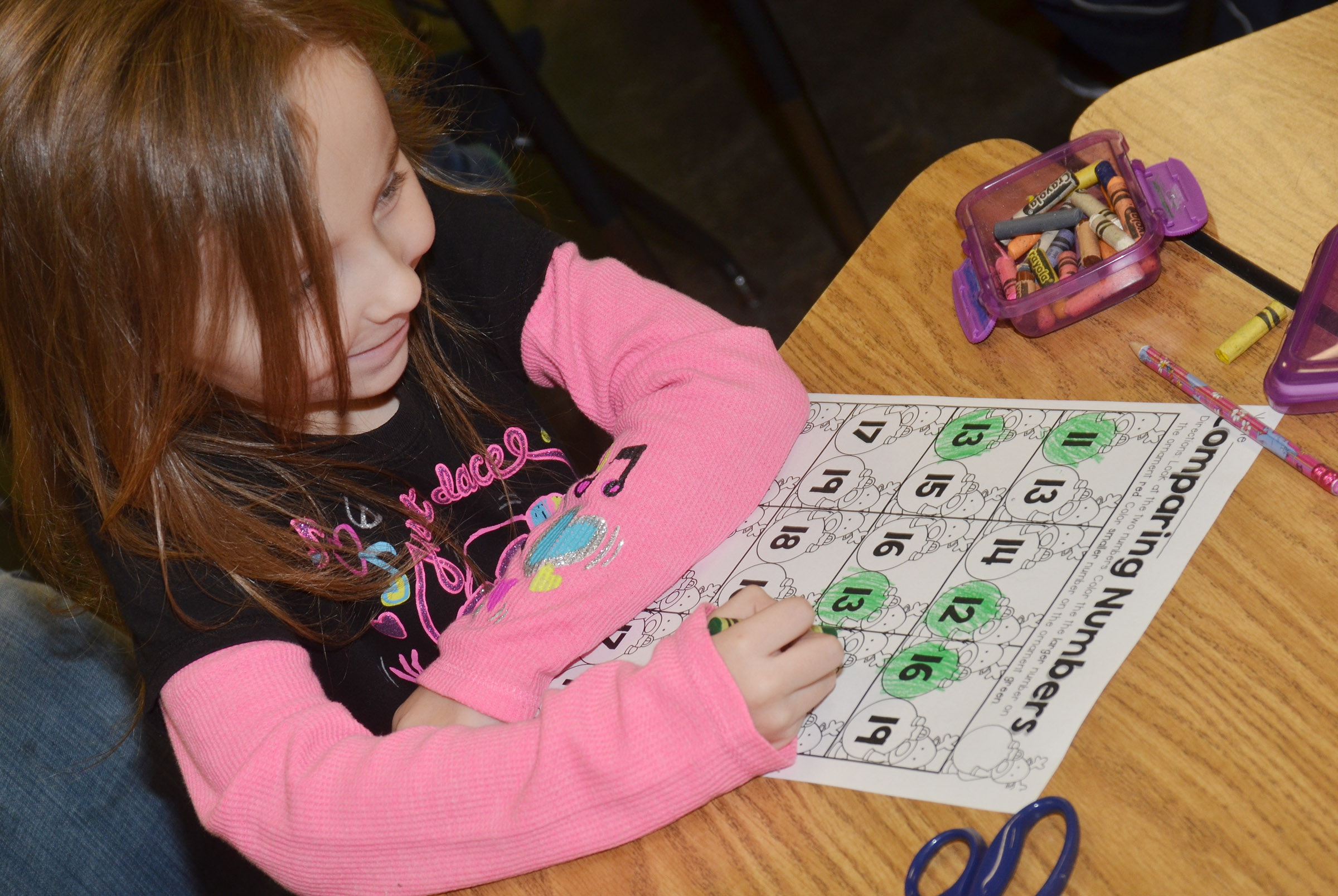 CES kindergartener Tabitha Leggett practices comparing numbers to see which is the largest.