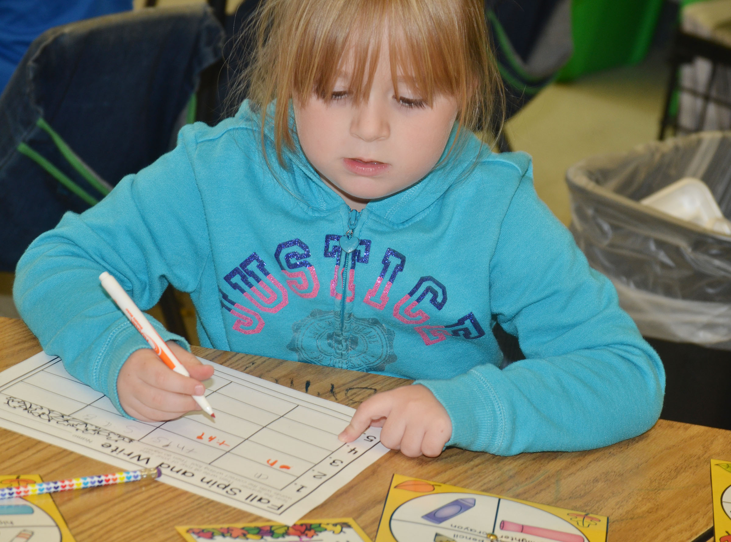 CES kindergartner Briley Sapp uses a marker to write her sight words.
