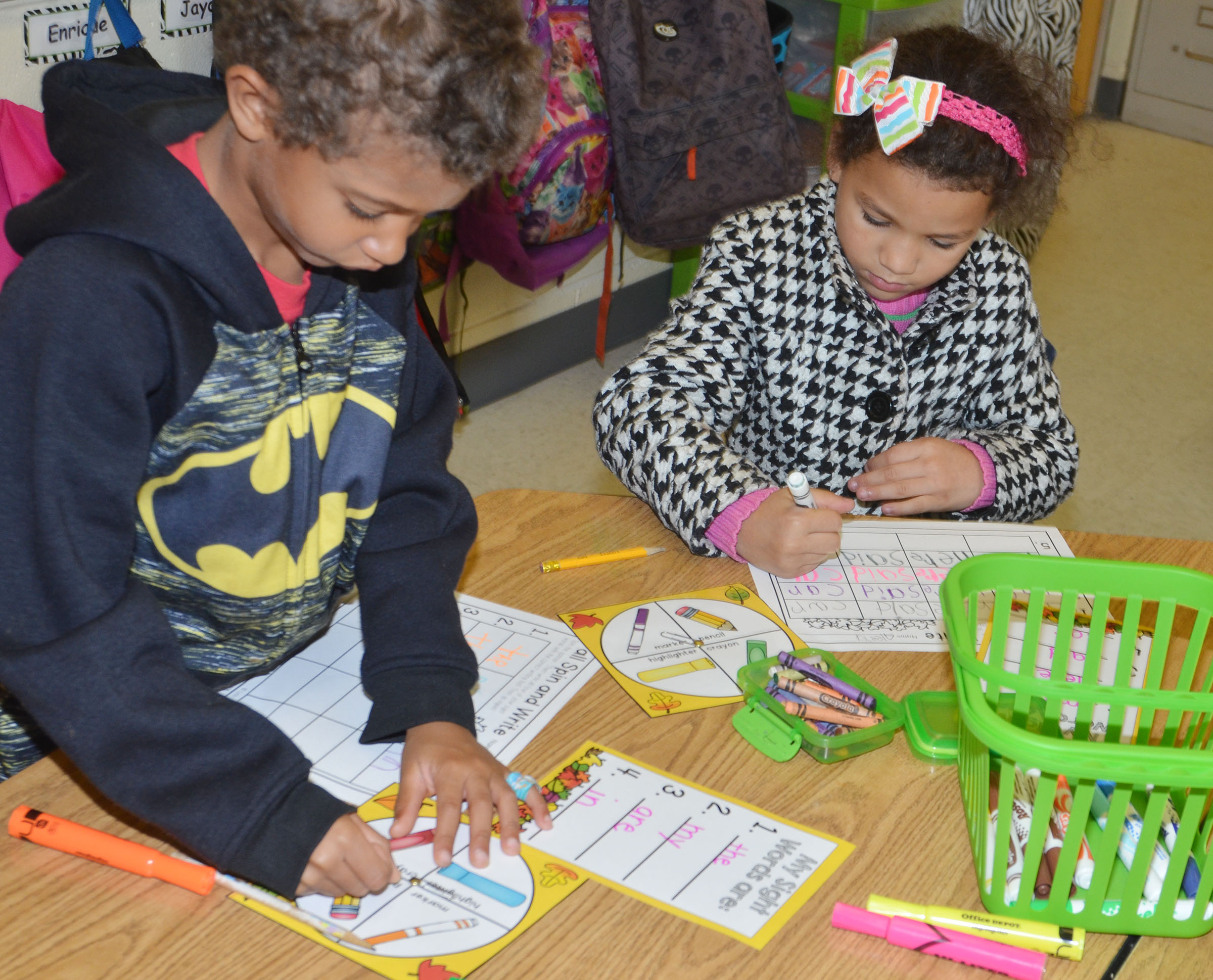 CES kindergarteners Tyce Owens, at left, and Aleeya Spaulding play a game to help them learn their sight words.