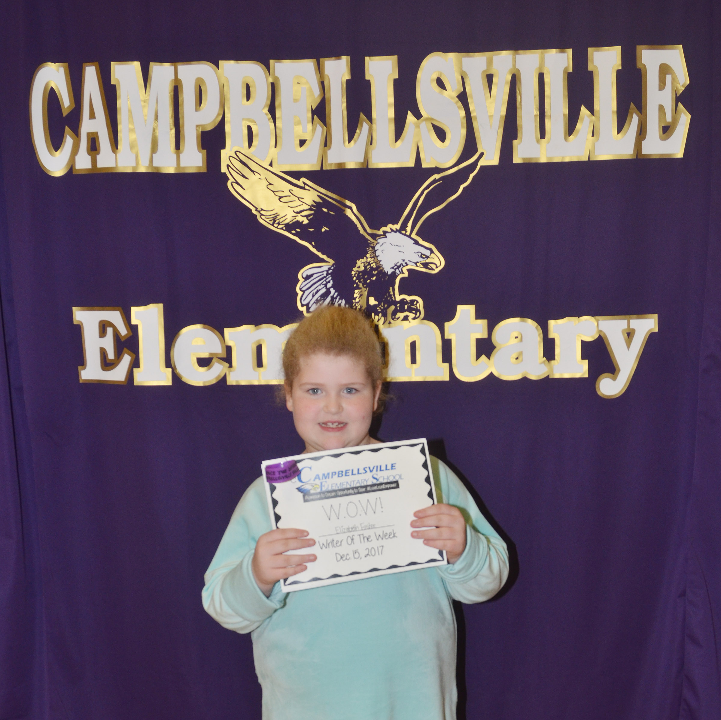 CES second-grader Elizabeth Foster is her school's Writer of the Week for the week of Dec. 11.