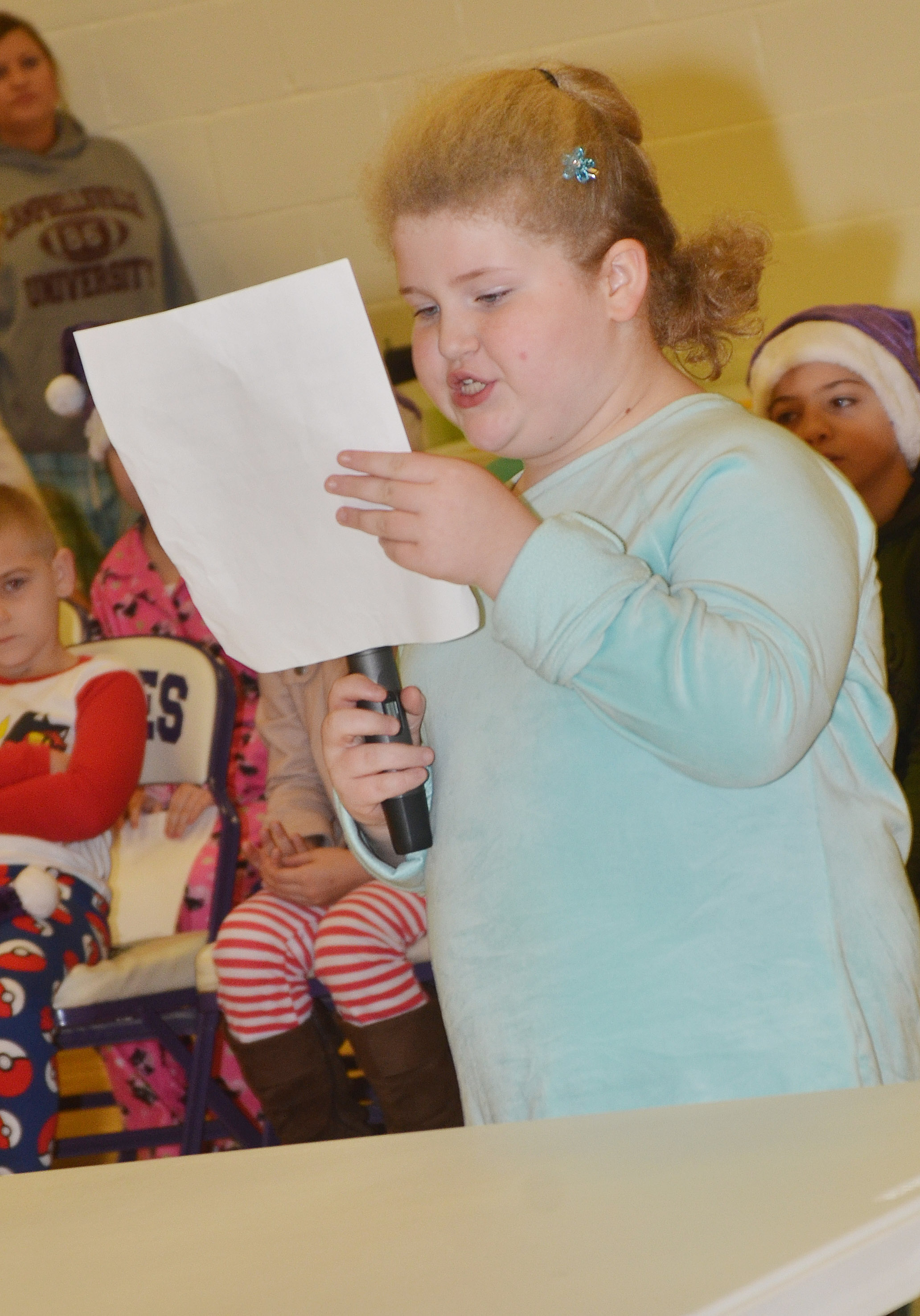 "CES second-grader Elizabeth Foster reads her essay about a field trip to see the movie ""The Star."""