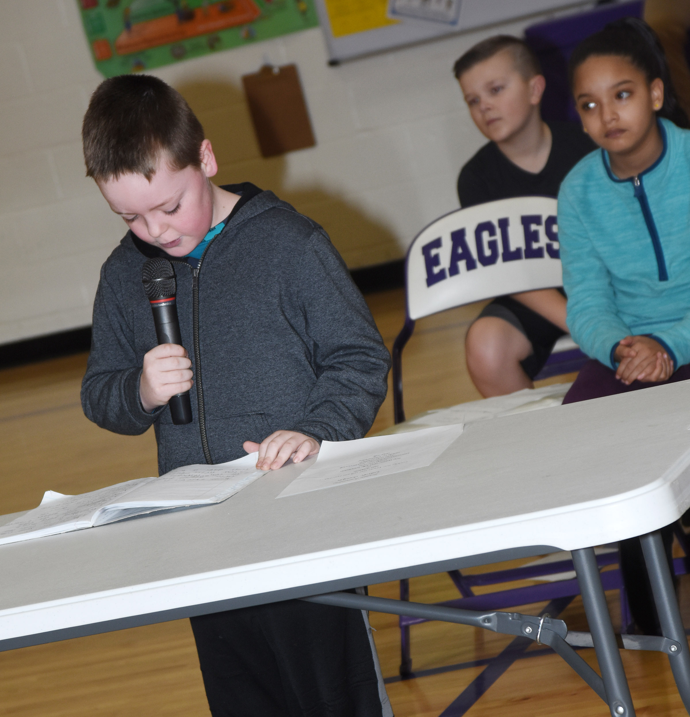 CES second-grader Eric Epperson reads his essay about the CES Wings Express program.