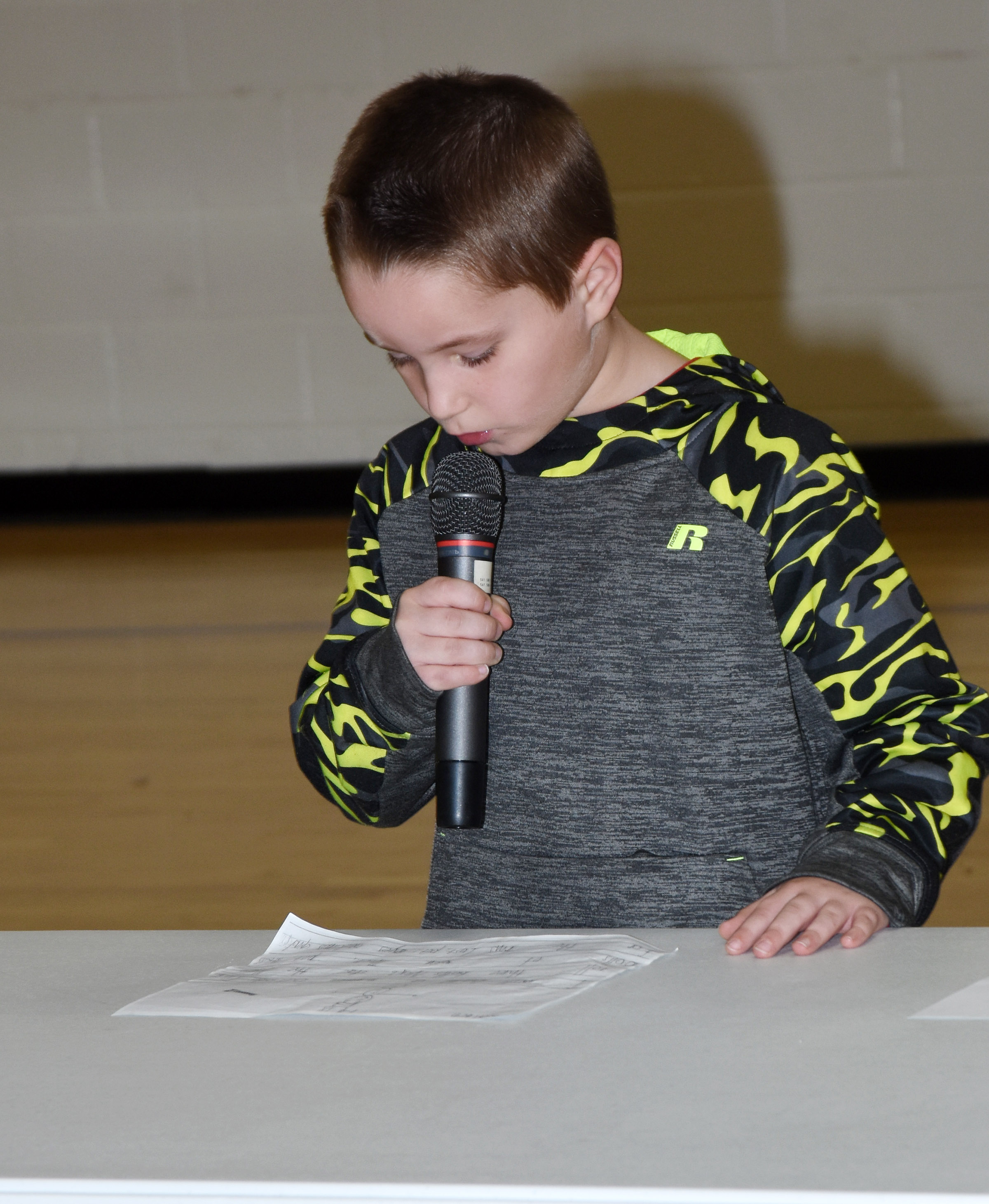 CES first-grader Kaiden Bradfield reads his essay about how to build a snowman.