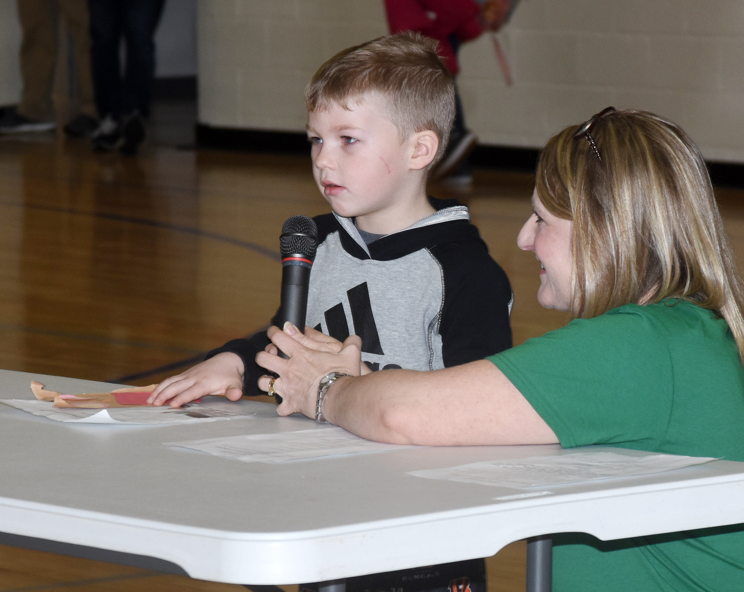 CES kindergartener Landry Brown reads his writing about his sister.