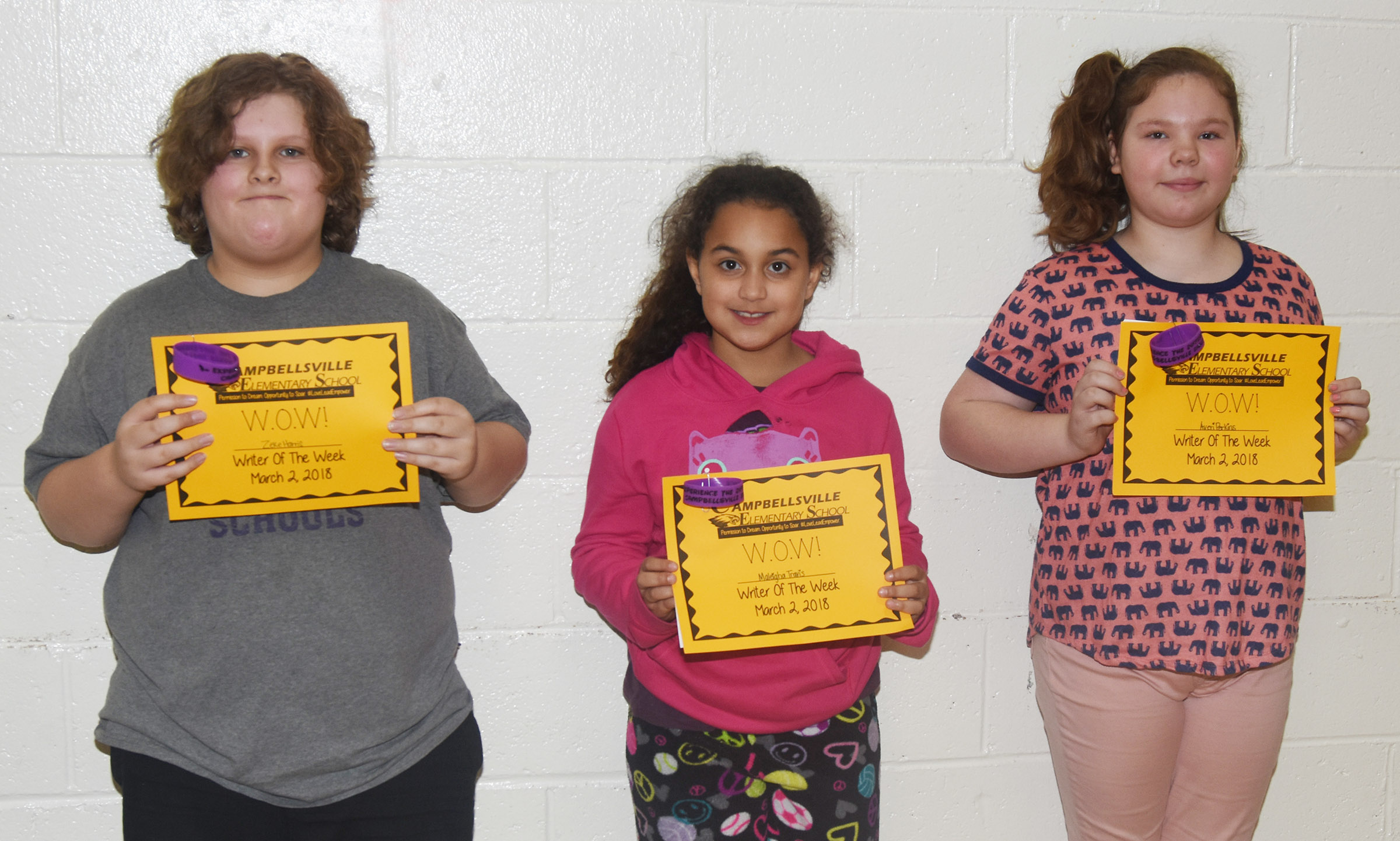 From left, CES fifth-grader Zeke Harris, second-grader Maleigha Travis and fifth-grader Averi Perkins are their school's Writers of the Week for the week of Feb. 26.