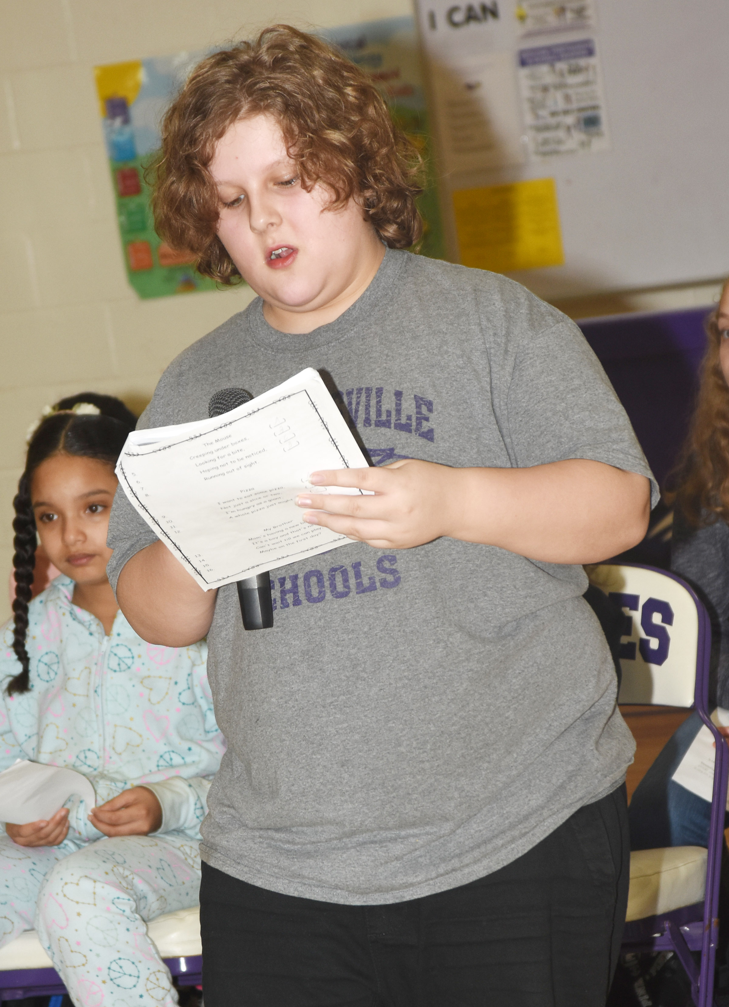 CES fifth-grader Zeke Harris reads his poem about going to school.