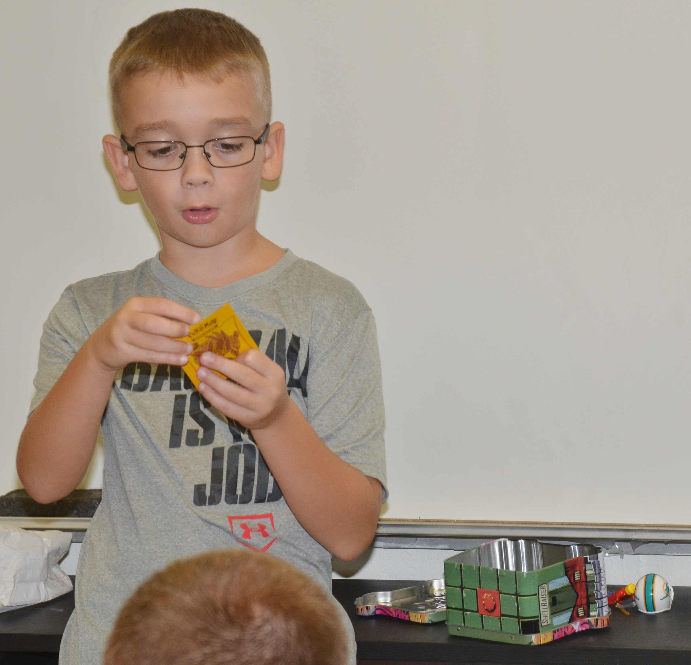 CES fourth-grader Cameron Estes says he loves Pokemon cards.