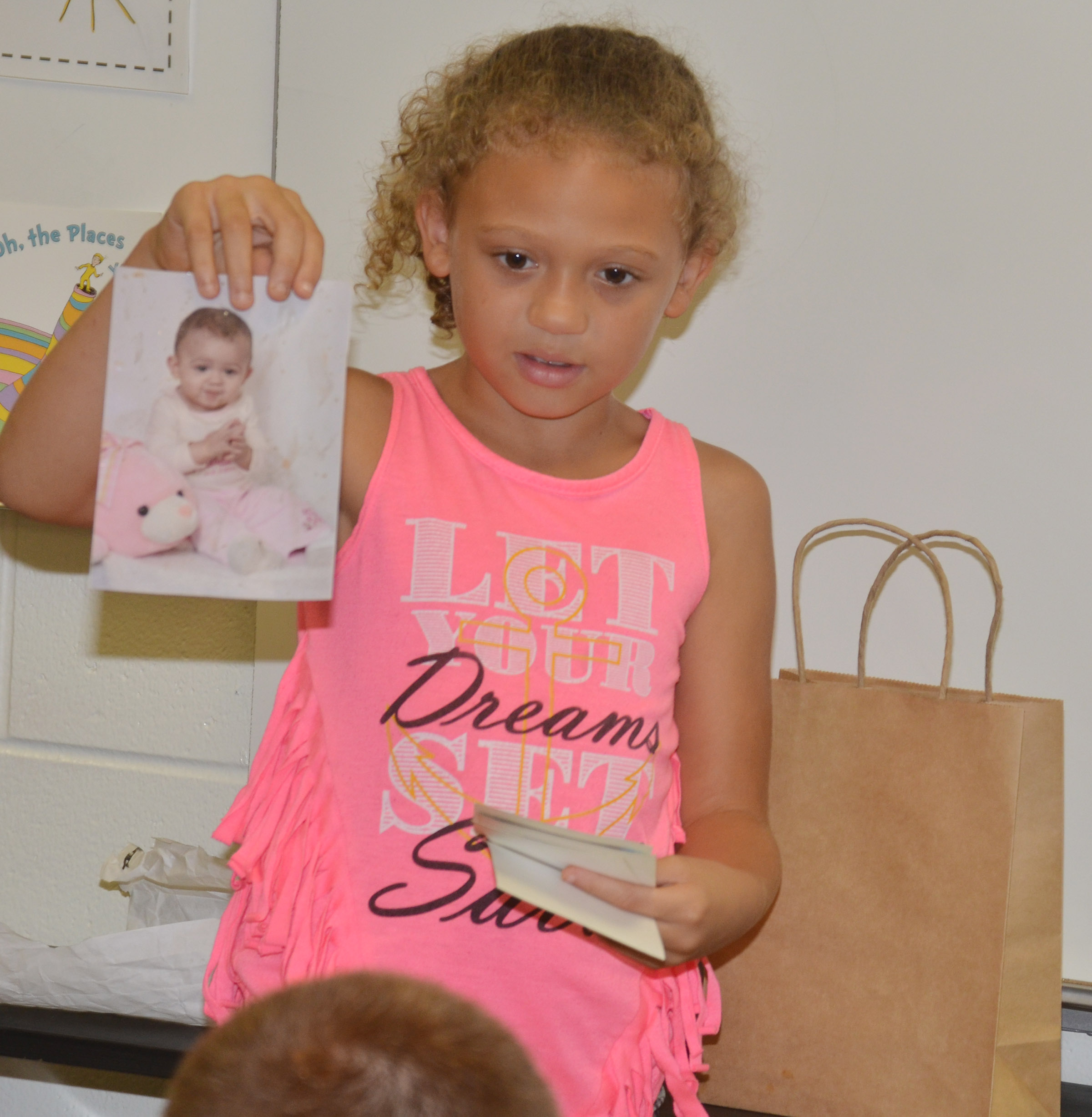 CES fourth-grader Alicia Spaulding holds one of her baby photos.
