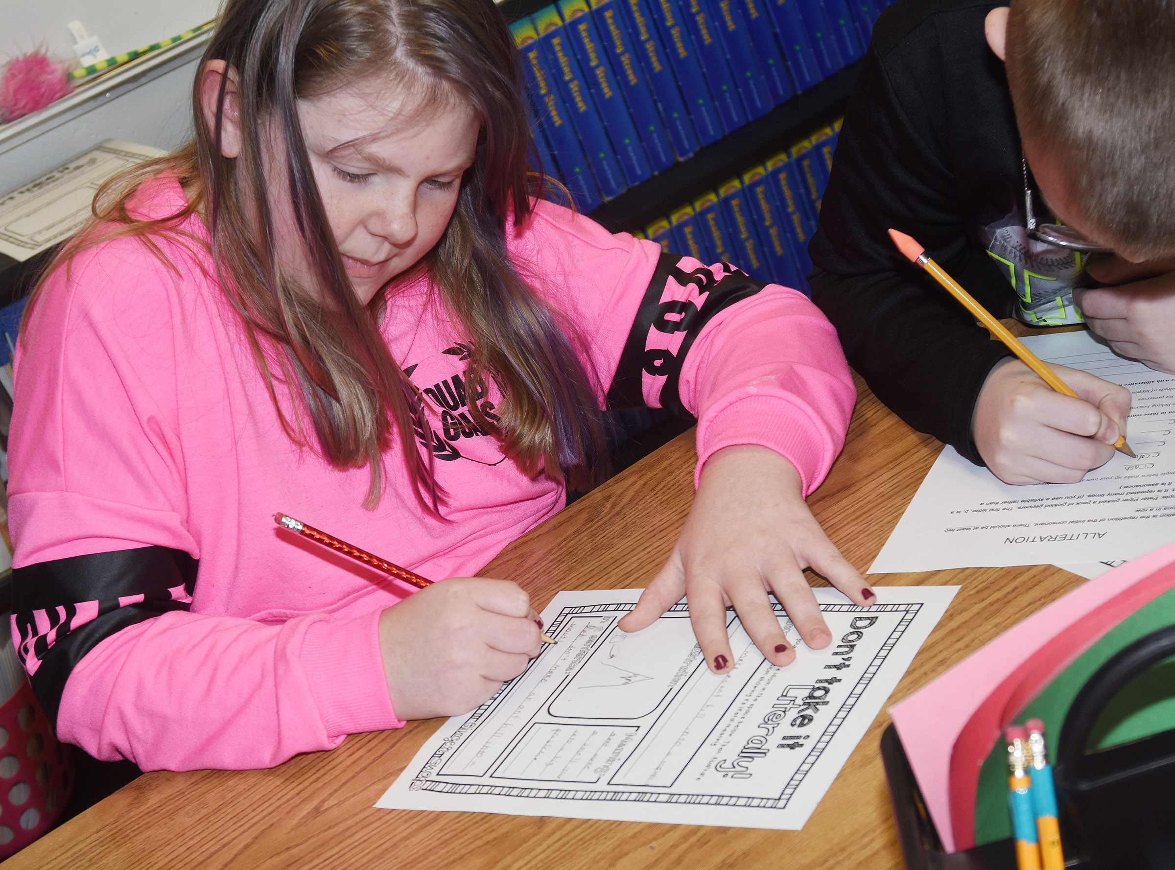 "CES fourth-grader Alyssa Bennett writes a sentence using the idiom ""making a mountain out of a molehill."""