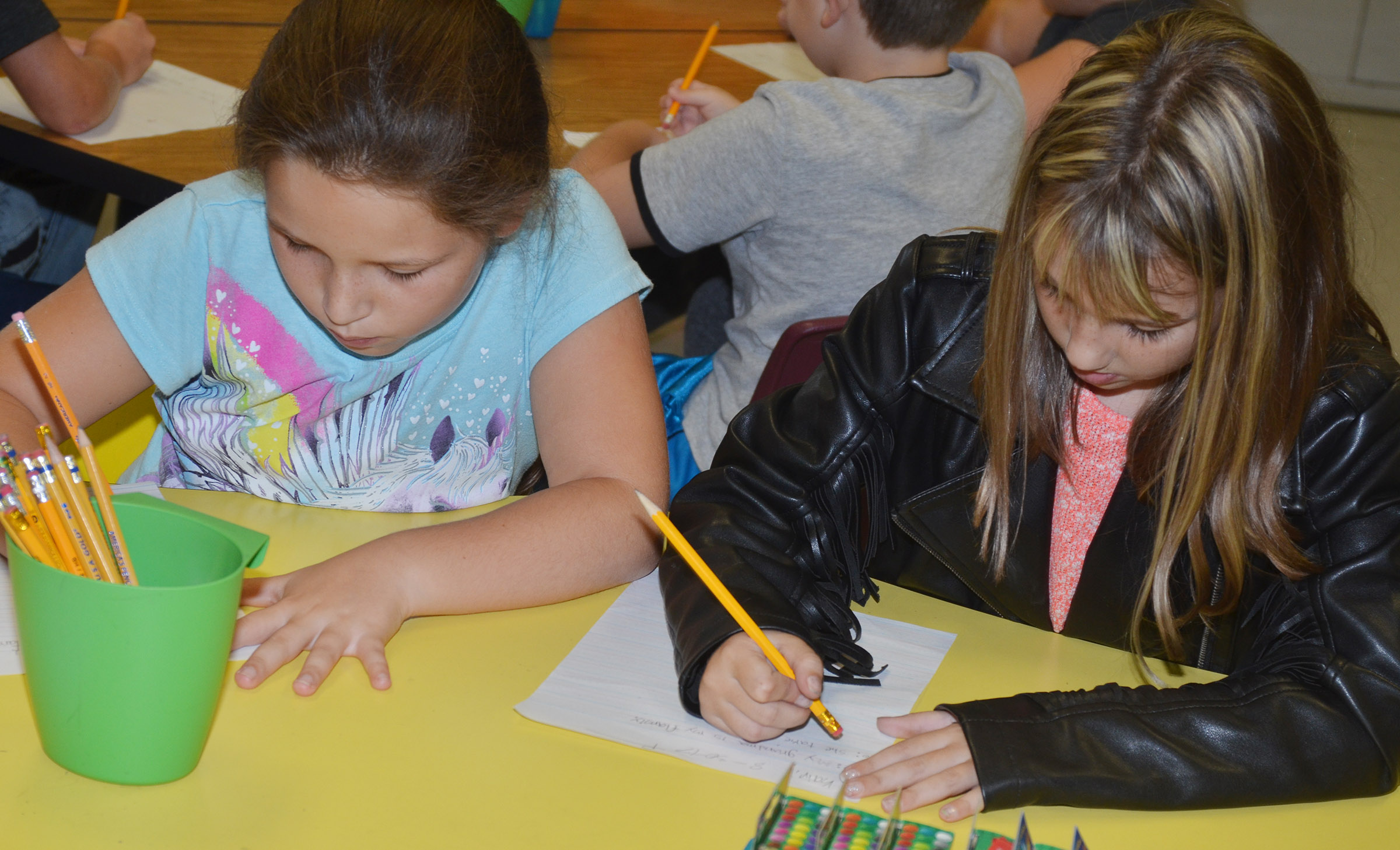 CES third-graders Keely Rakes, at left, and Kairi Tucker write about their grandparents.