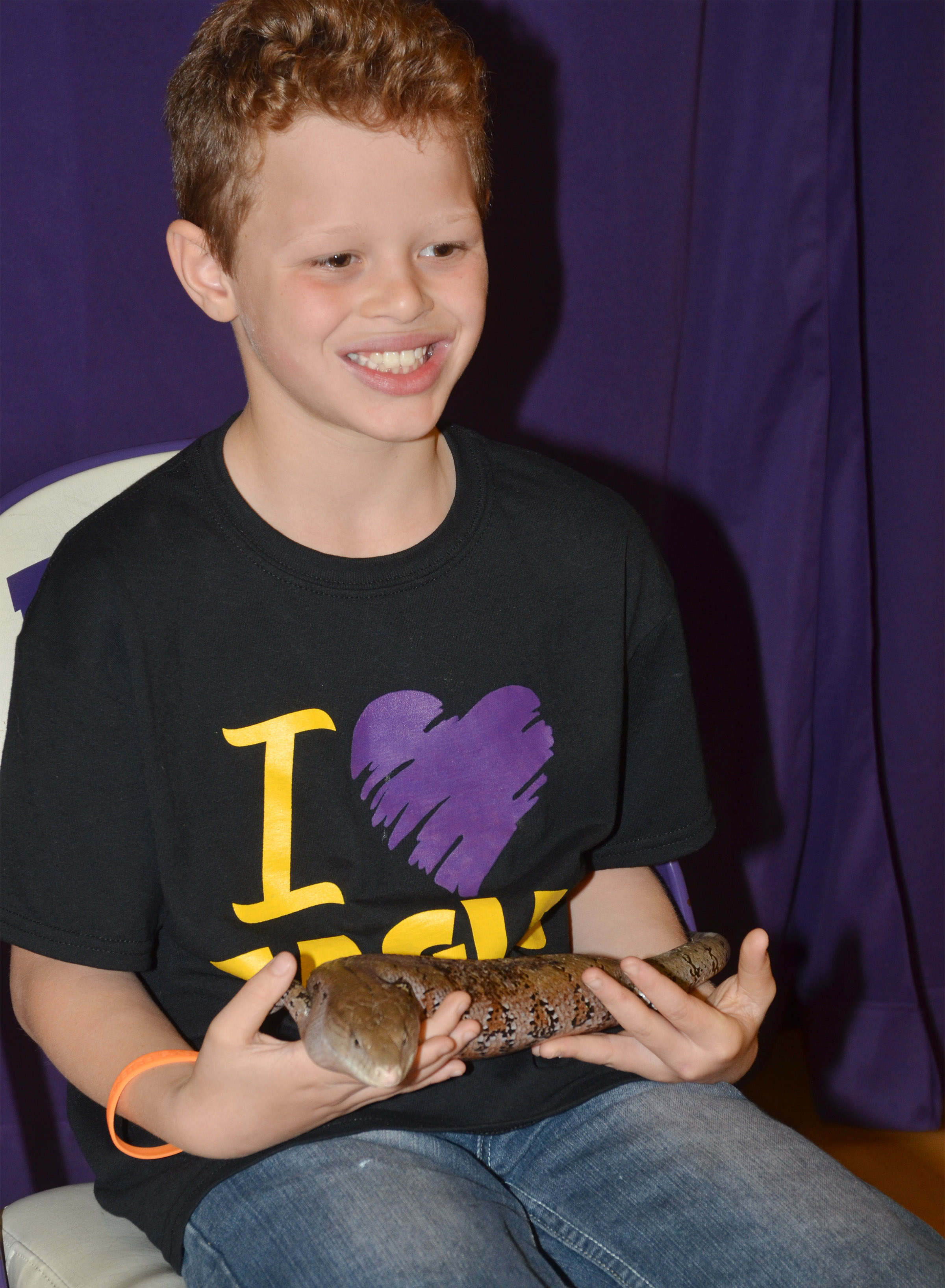 CES third-grader Demetrious Dickens holds the blue tongue skink.