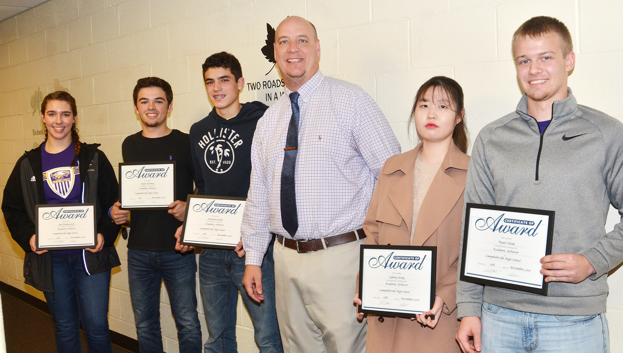 Campbellsville High School academic achievers for November were recognized at the Campbellsville Board of Education meeting on Monday, Nov. 13. Pictured with CHS Principal David Petett they are, from left, freshman Abi Wiedewitsch, junior Ryan Kearney, freshman Kameron Smith, Petett and seniors Sydney Jeong and Wyatt Houk. Absent from the photo are sophomores Blake Allen and Sydney Wilson and junior Elizabeth Sullivan.