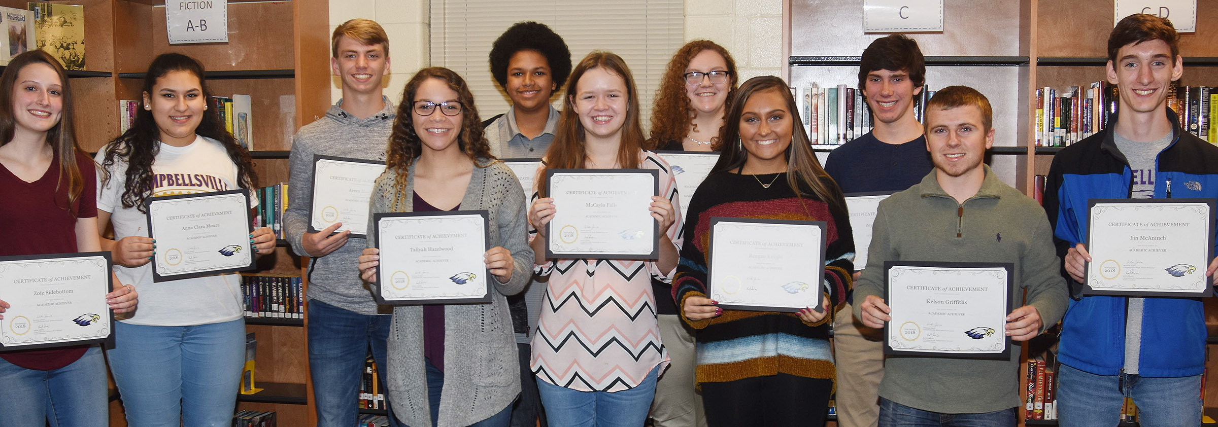 CHS academic achievers for November were honored at the Campbellsville Board of Education meeting on Monday, Nov. 12. They are, from left, sophomores Zoie Sidebottom, Anna Clara Moura and Arren Hash, junior Taliyah Hazelwood, freshmen Tezon Mitchell and MaCayla Falls, junior Emily Rodgers, senior Reagan Knight, freshman Peyton Dabney, junior Kelson Griffiths and senior Ian McAninch. Absent from the photo is senior Davon Cecil.