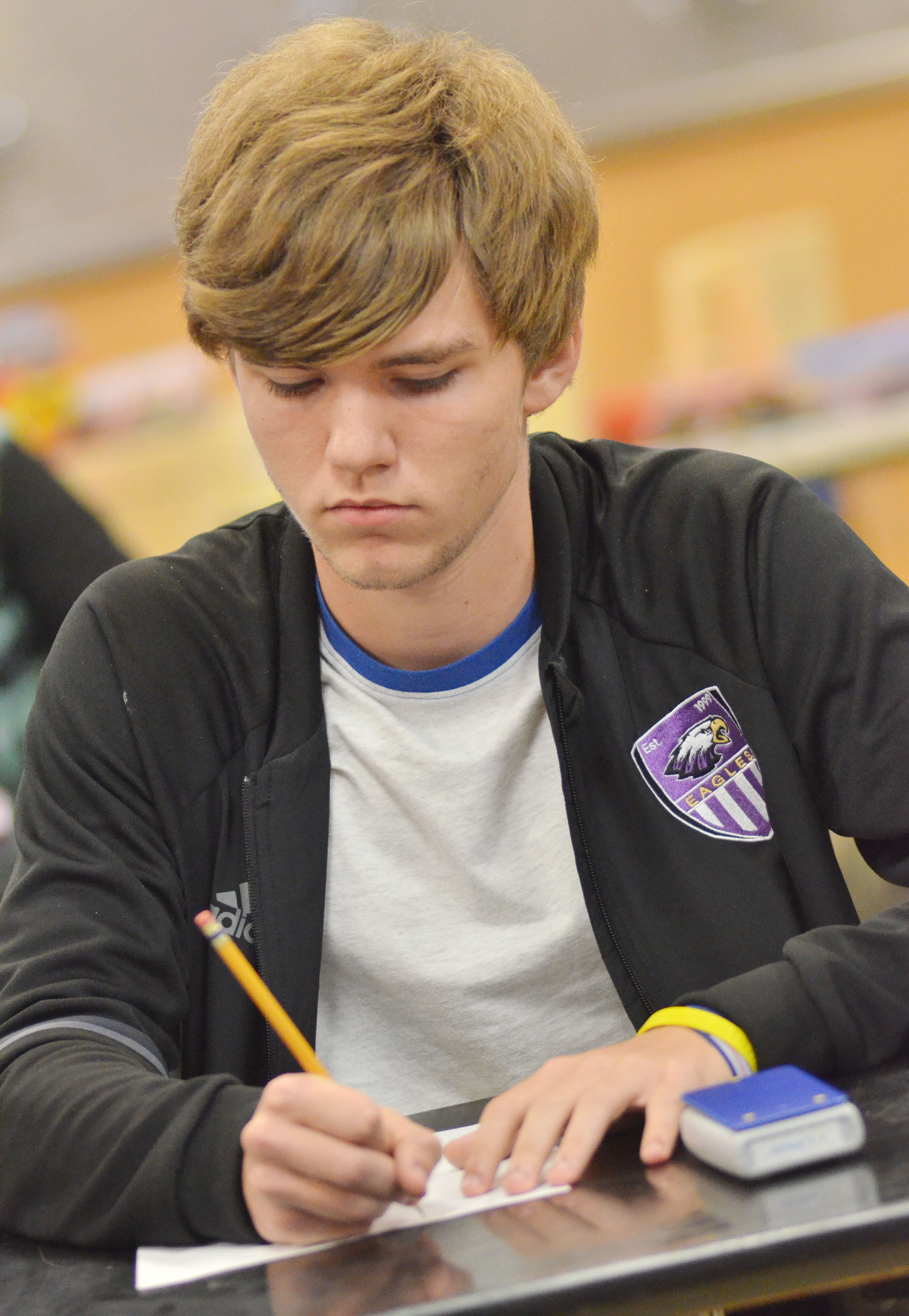 CHS junior Christian Berry works a math problem.