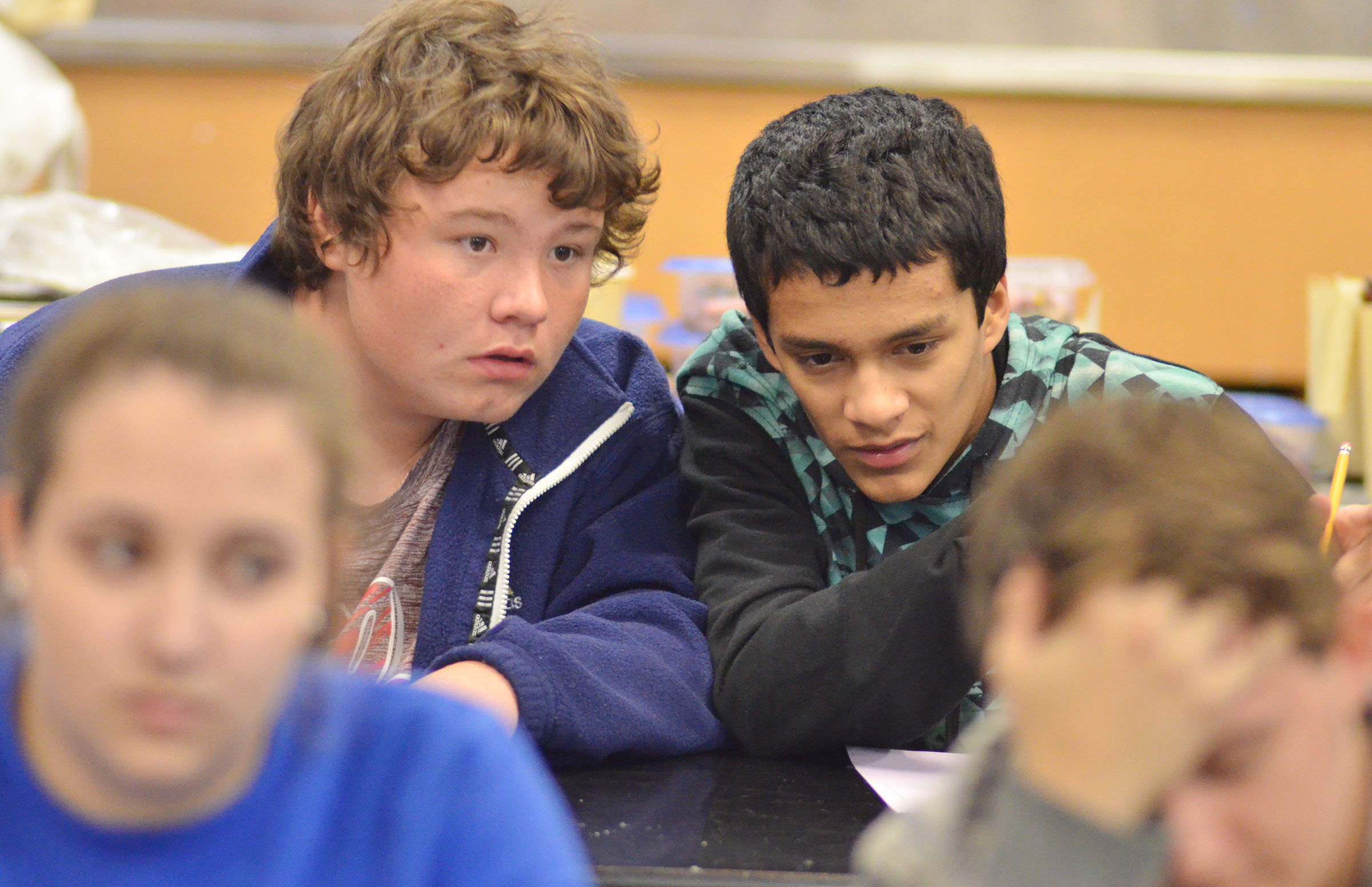 CHS freshmen Conner Riley, at left, and Ben Arachi discuss a question as their teammates listen to it.