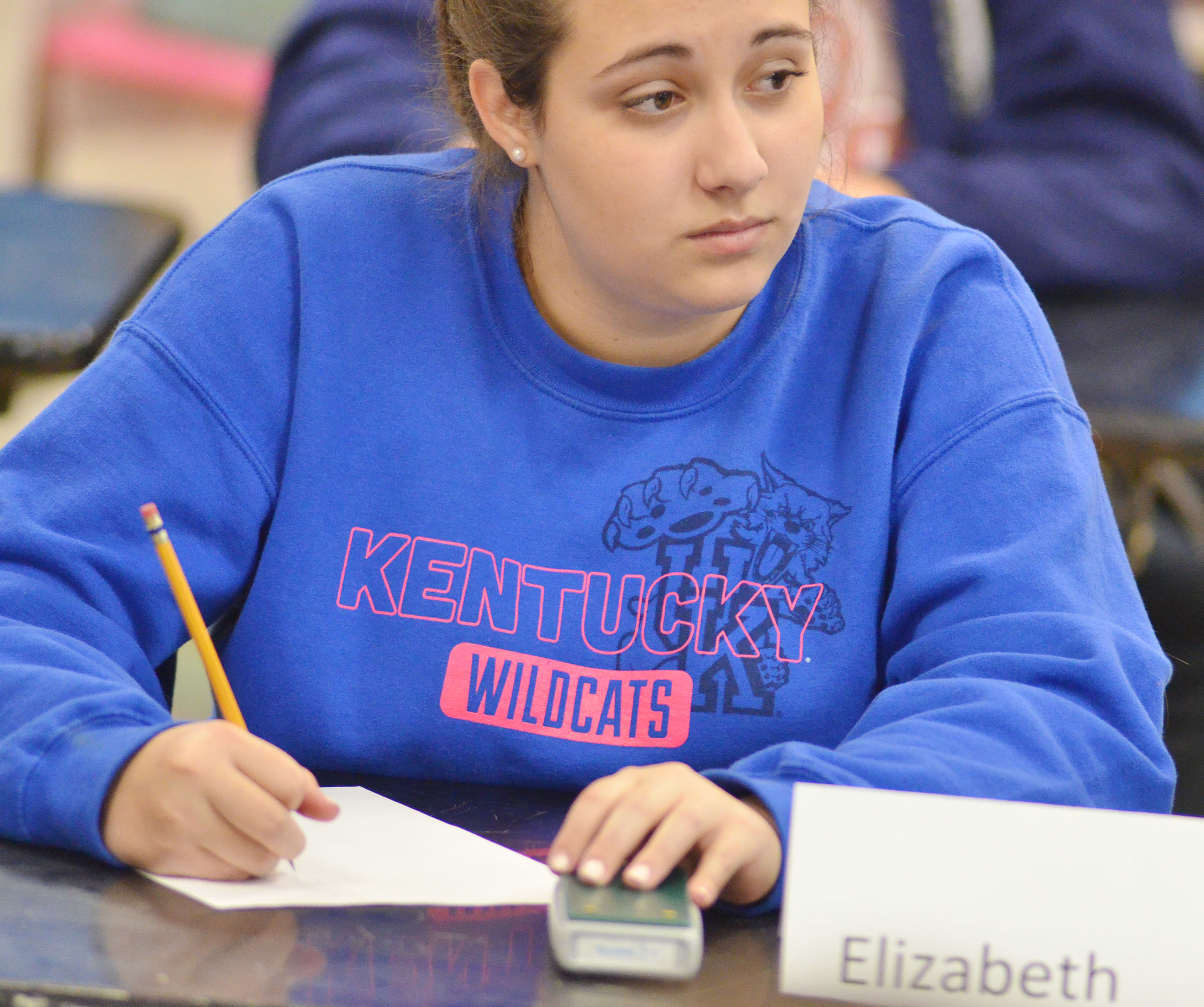 CHS sophomore Elizabeth Sullivan listens to a question before buzzing in to answer.