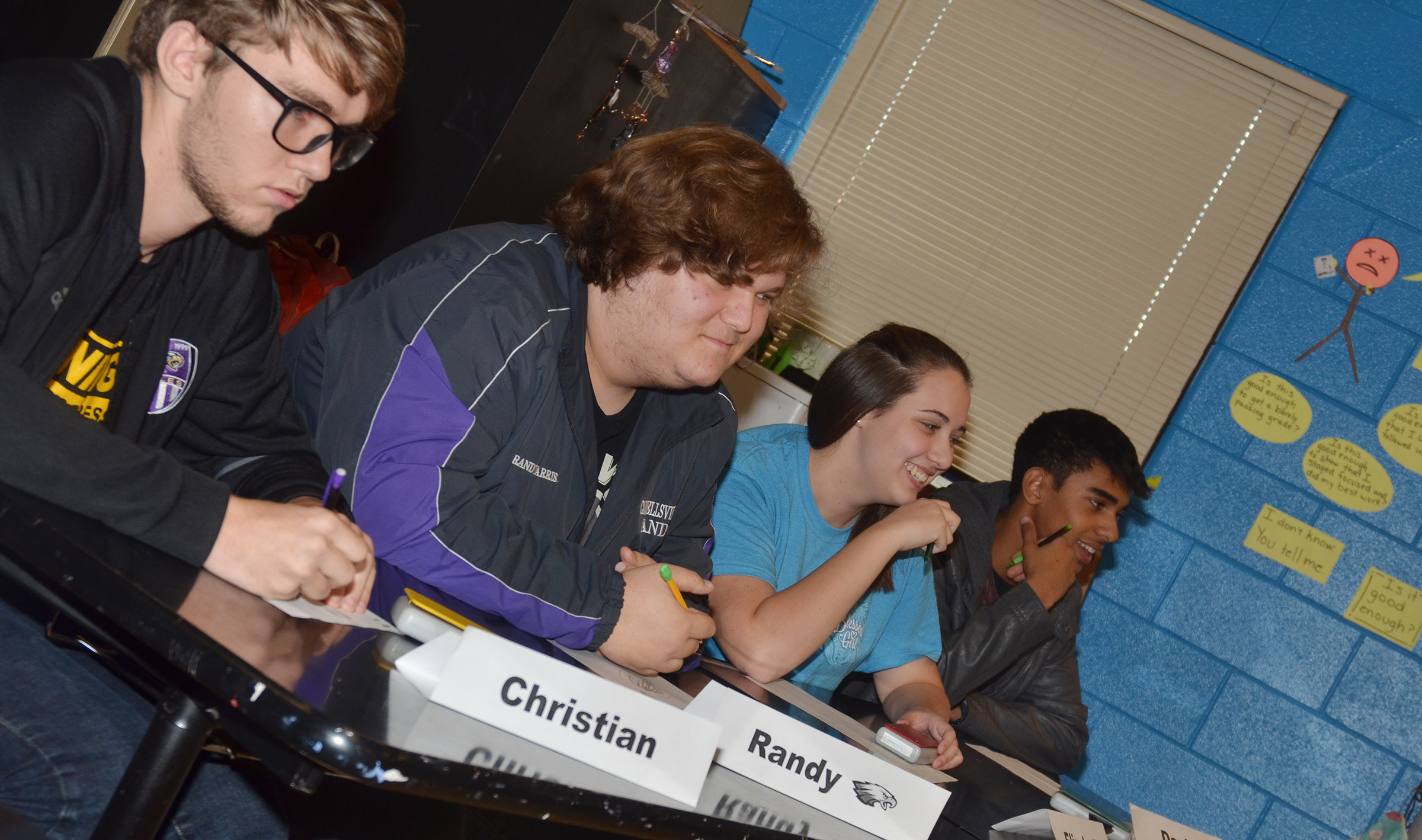 From left, CHS academic team members Christian Berry, a senior, juniors Randy Harris and Elizabeth Sullivan and sophomore David Silva listen to a question.