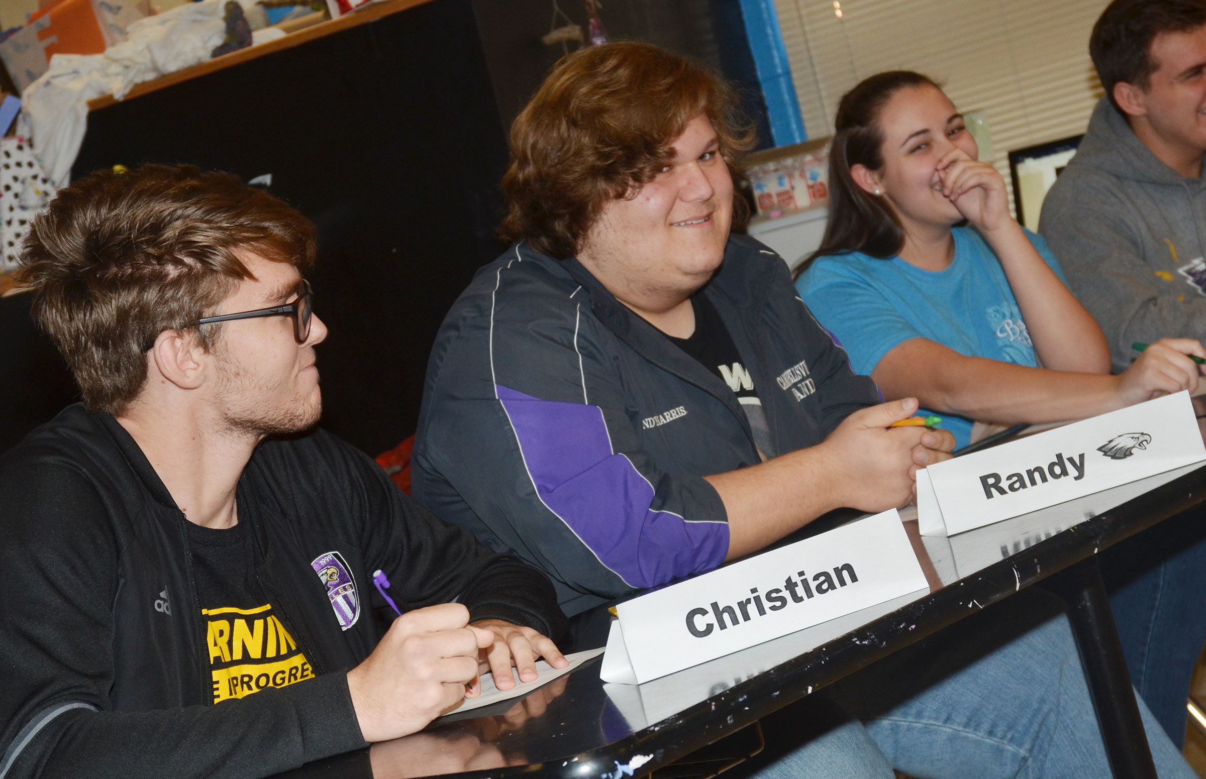 From left, CHS senior Christian Berry, juniors Randy Harris and Elizabeth Sullivan and senior Austin Fitzgerald share a laugh as they answer a question.