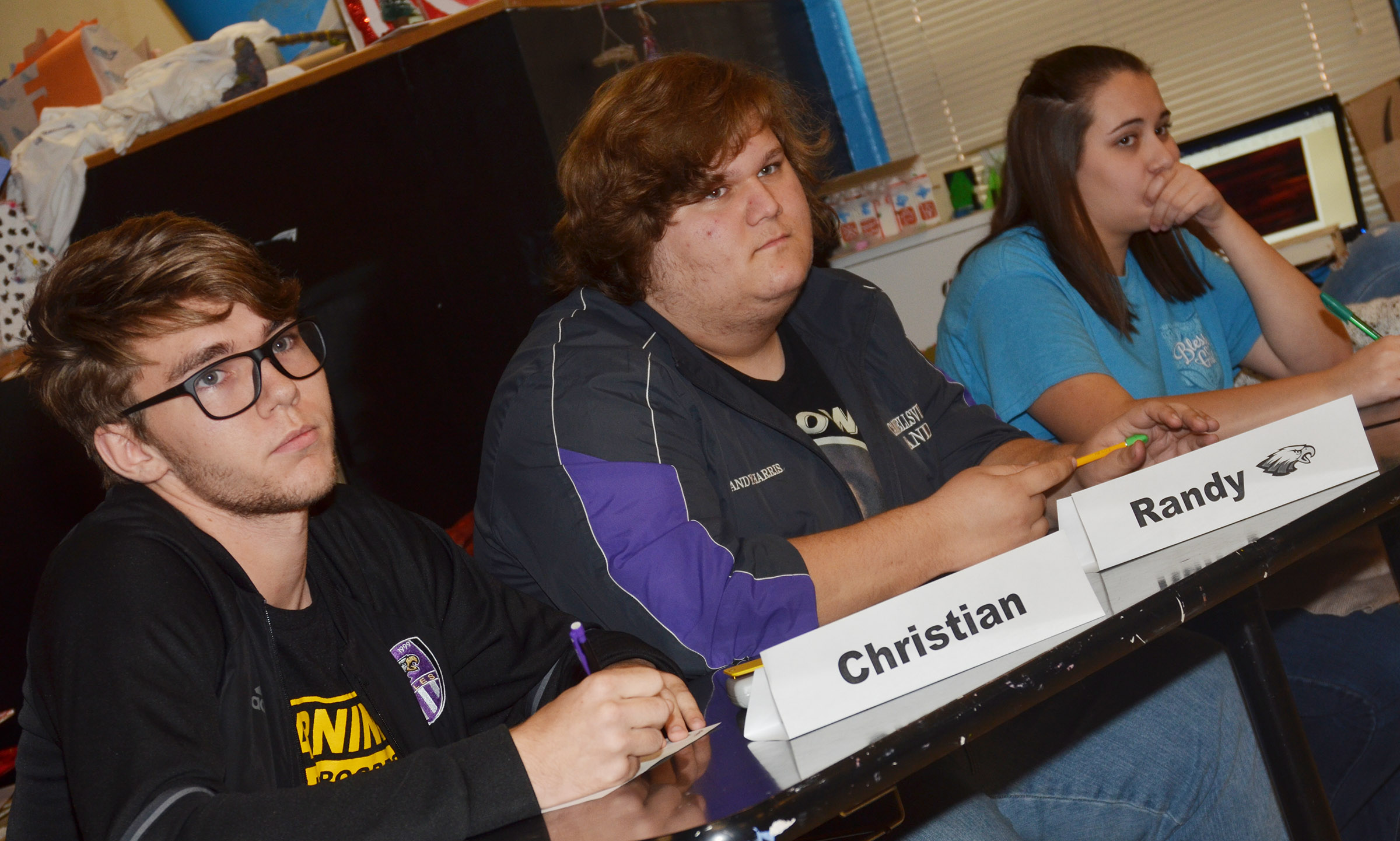 From left, CHS academic team members Christian Berry, a senior, and juniors Randy Harris and Elizabeth Sullivan listen to a question.