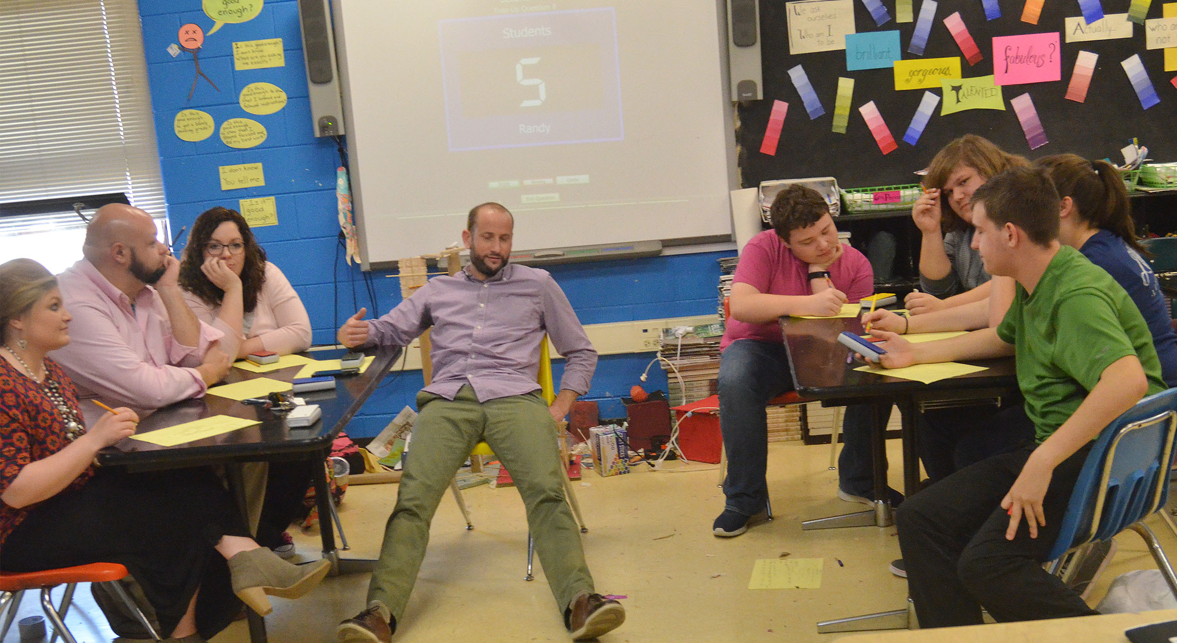 CHS teachers battle academic team members in a quick recall challenge.