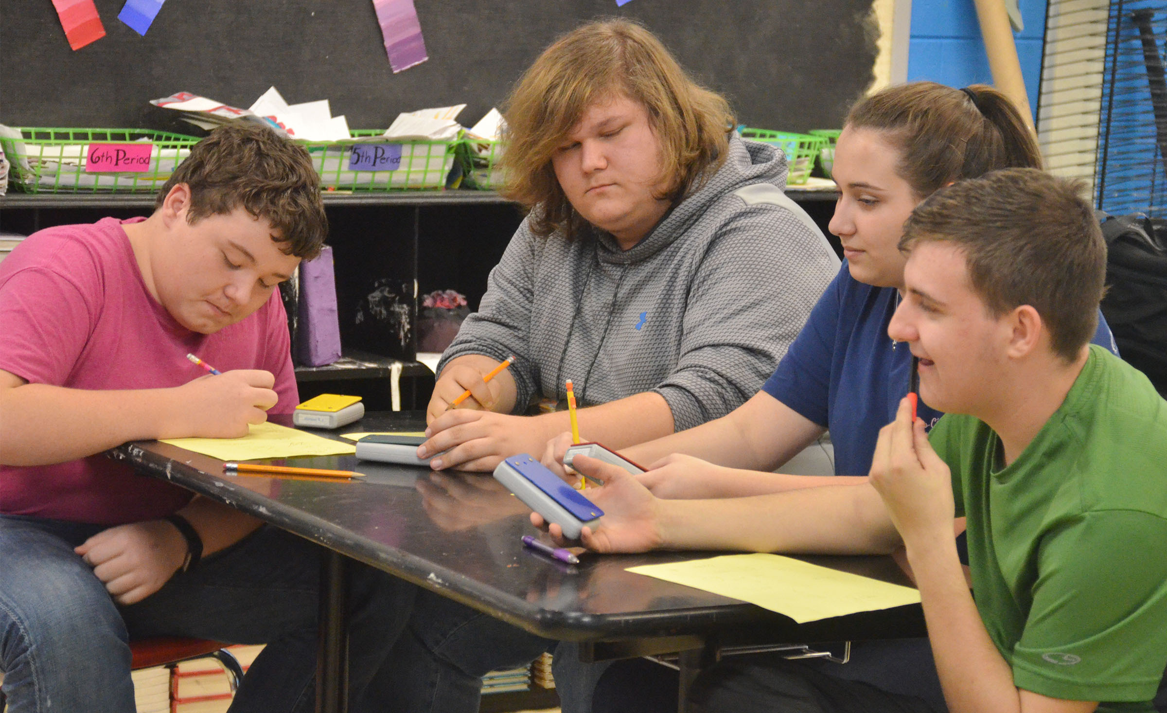 CHS academic team members, from left, freshman Conner Riley, sophomore Randy Harris, freshman Elizabeth Sullivan and junior Austin Fitzgerald listen to a question.