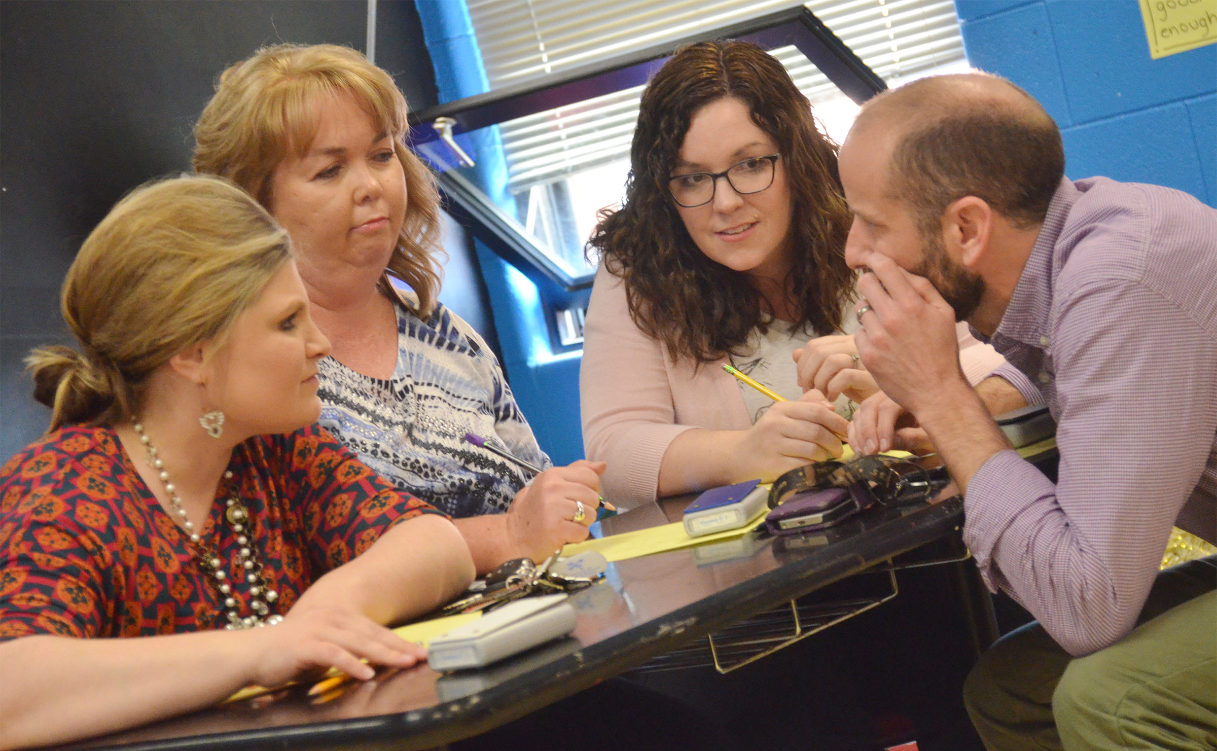 CHS teachers, from left, Lauren Bennett, Sonya Kessler, Lindsay Williams and Ben Davis discuss a question.