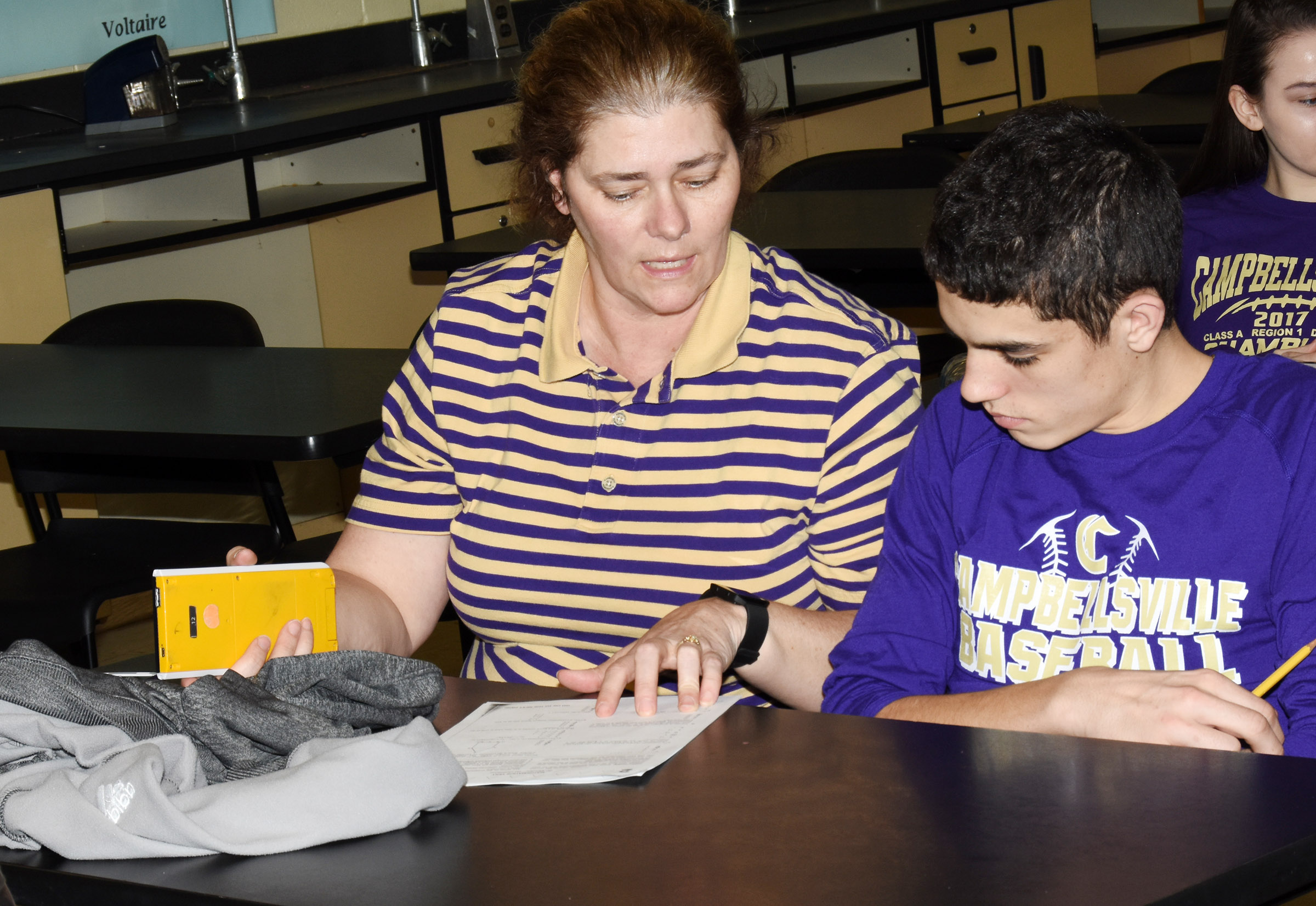CHS math teacher Tammy Wilson helps freshman Kameron Smith during an ACT workshop.