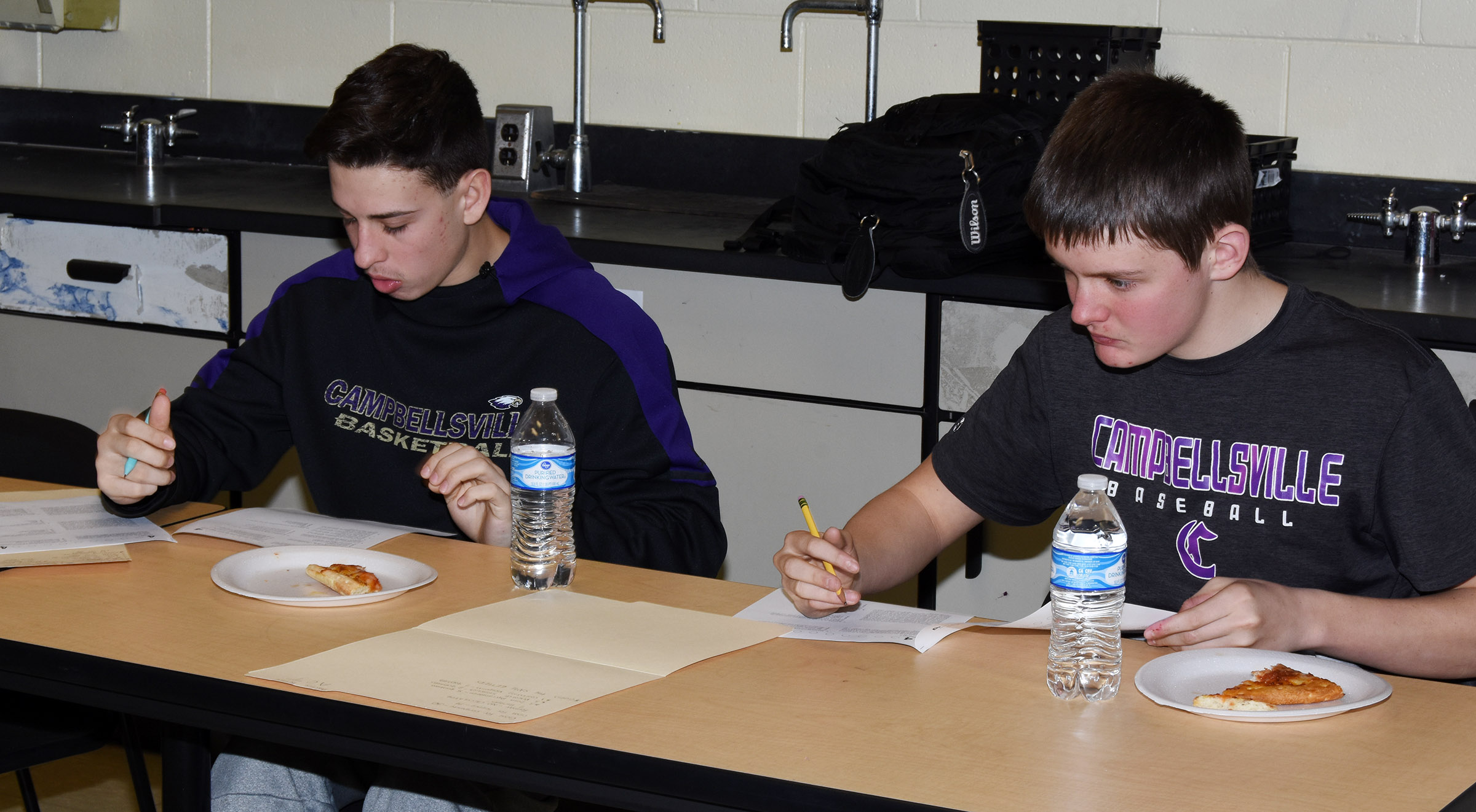 CHS freshman John Orberson, at left, and sophomore Blake Allen answer science questions during an ACT workshop.