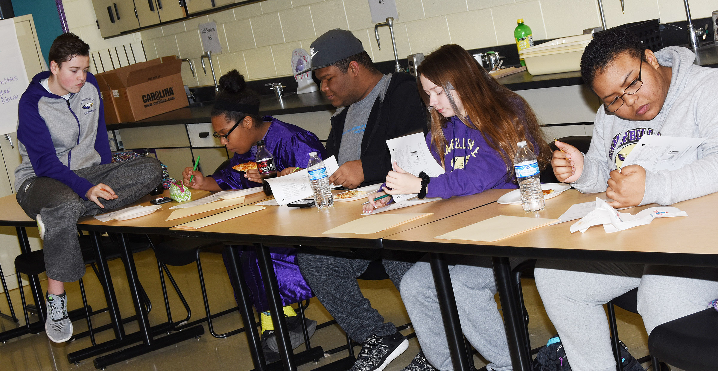 CHS students, from left, sophomores Gavin Johnson and Zaria Cowan and juniors Jeremiah Jackson, Christa Riggs and Natalie Caldwell answer questions during a science ACT workshop.