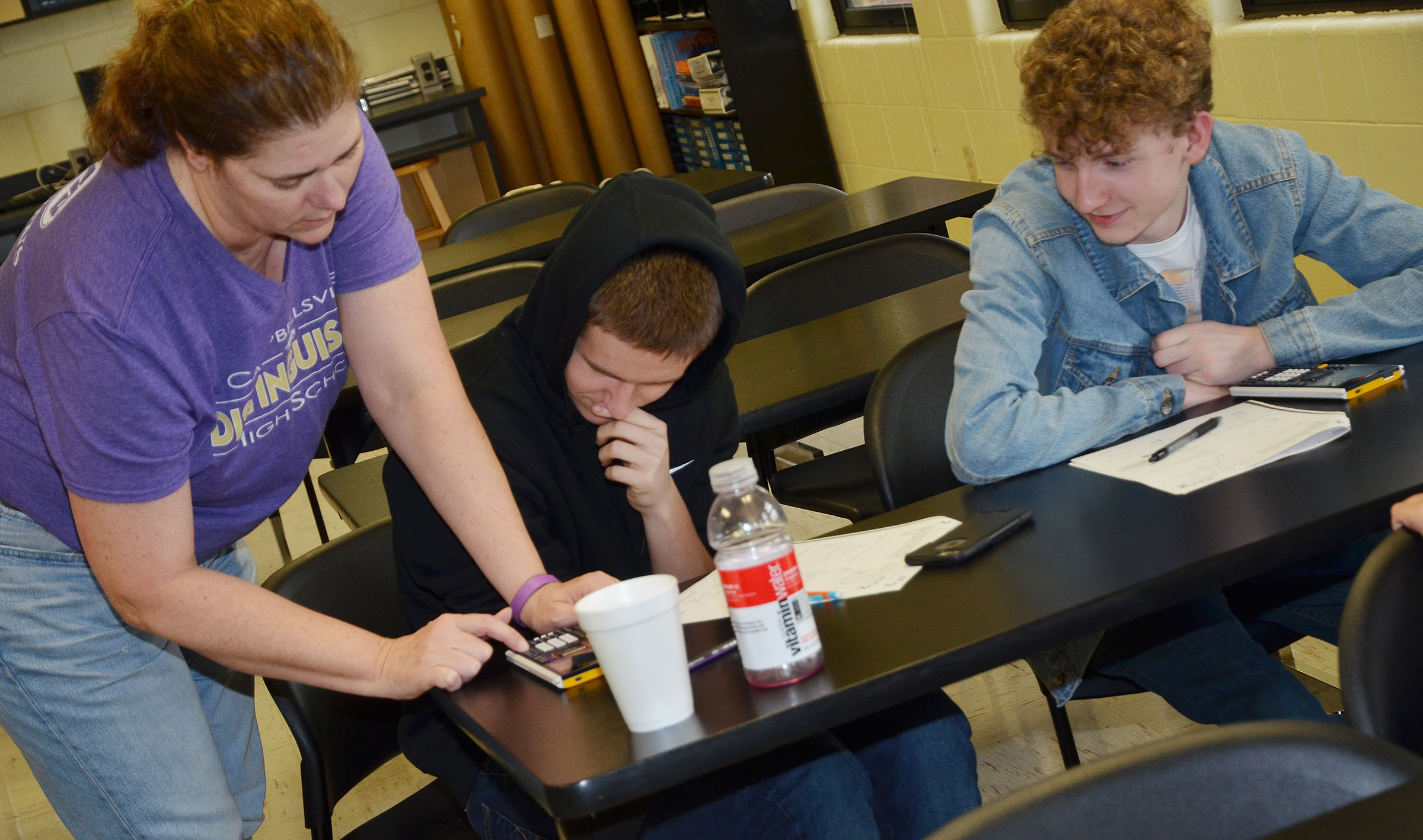 CHS teacher Tammy Wilson helps sophomores Myles Murrell, center, and Jackson Hinton with a sample math ACT question.