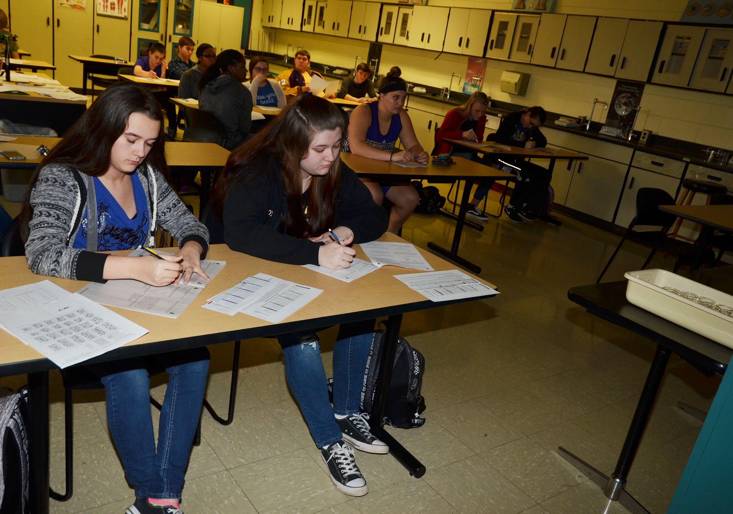 CHS juniors Makala Antle, at left, and Lauren Riddle read sample science ACT questions during a workshop.