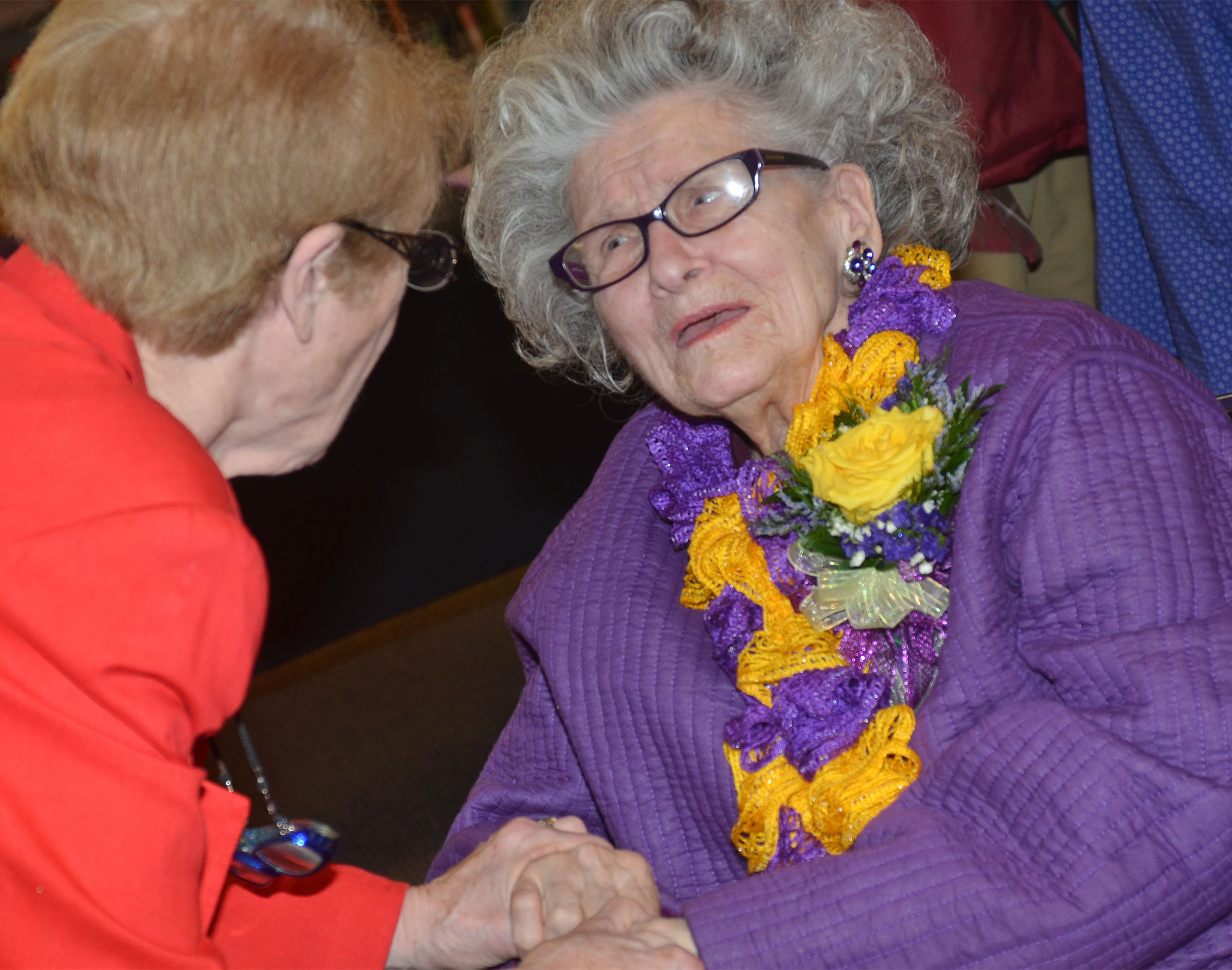 Former CHS employee Anne Fraim shares a laugh with friend Carole Mobley.
