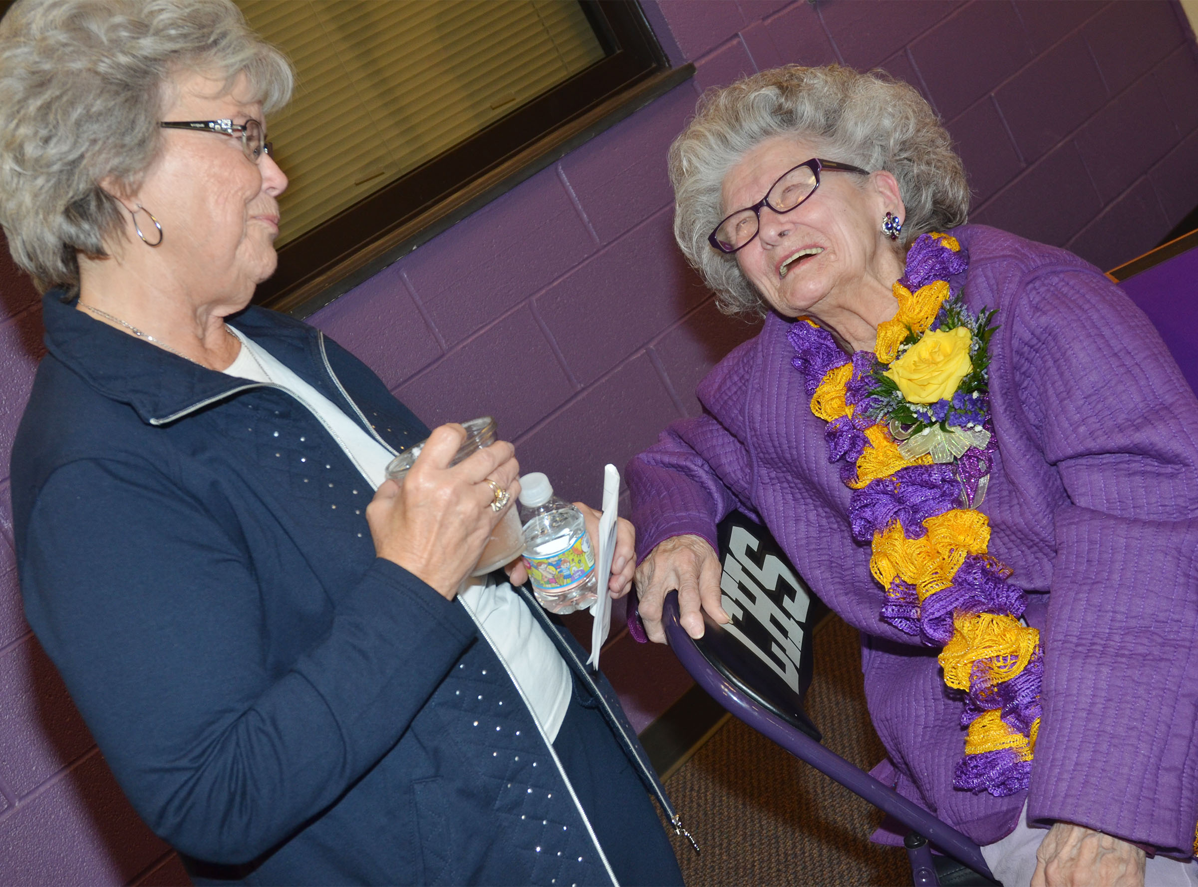 Former CHS employee Anne Fraim laughs with friend Betty Kidwell.