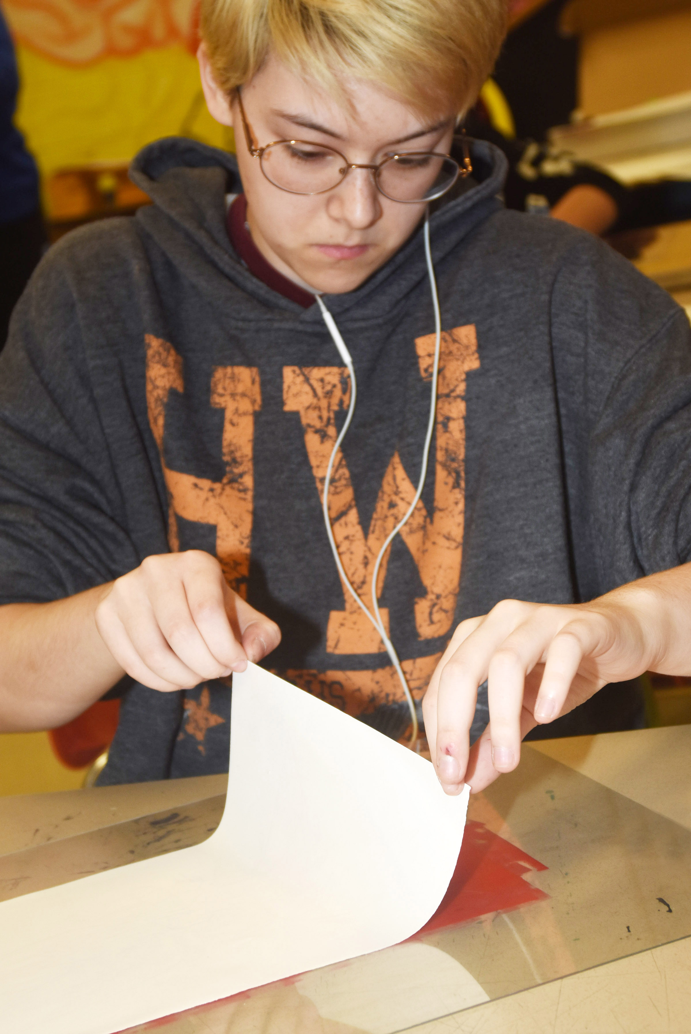 CHS senior Chloe Decker pulls her paper from ink to make a monoprint.